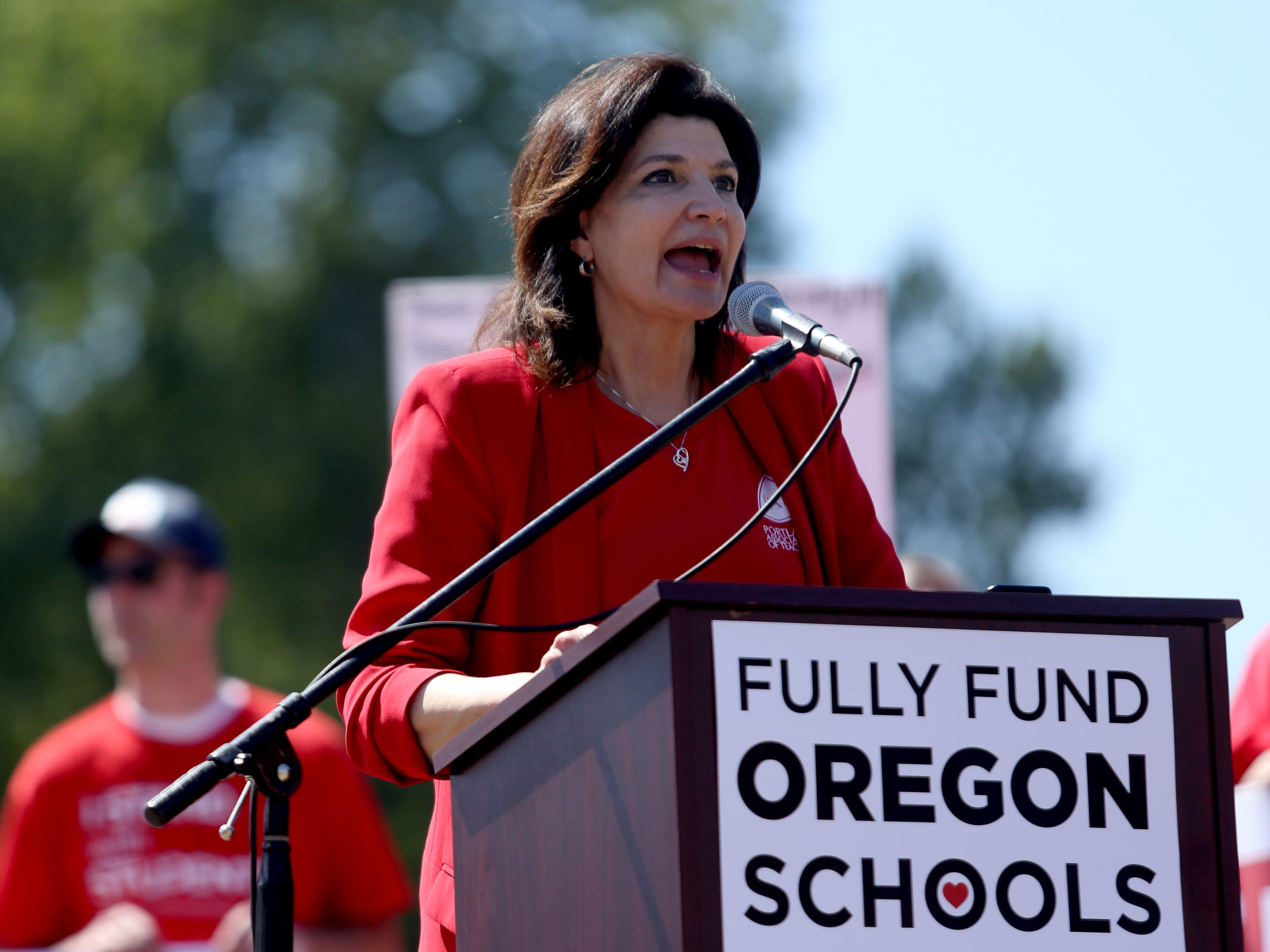 Lily Eskelsen Garc'a, the National Education Association president, speaks as thousands of teachers and education activists rally for a day of action starting at Riverfront Park in Salem on May 8, 2019. Schools across Oregon closed early or were closed for the day as teachers walked out to demand more school funding to address large class sizes, low graduation rates and other concerns.