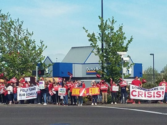 Supporters rally in Woodburn on the Oregon 'Day of Action' for state education funding.