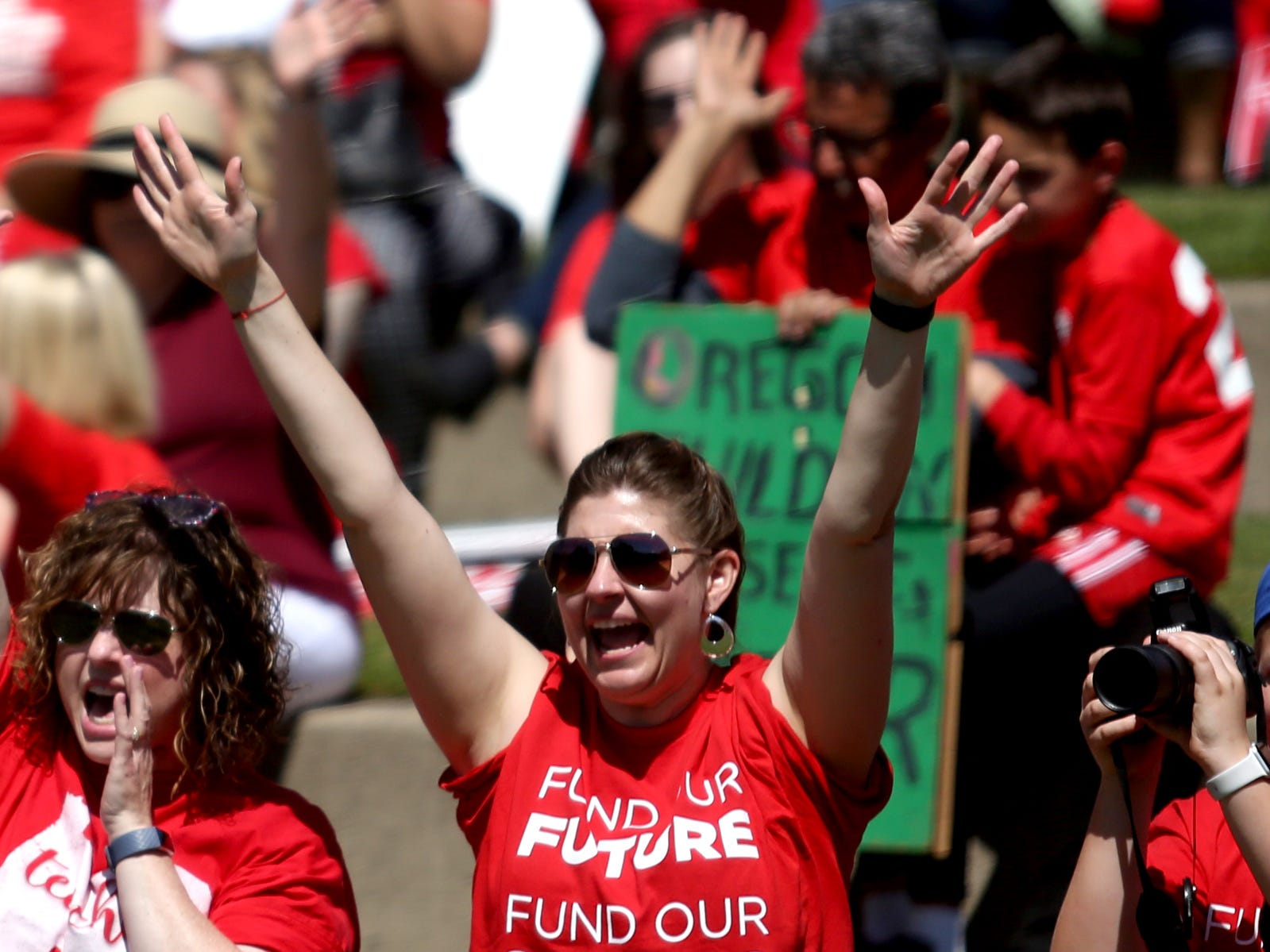 Cortney Clendening, a first grade teacher at Clear Lake Elementary School, cheers as thousands of teachers and education activists rally for a day of action starting at Riverfront Park in Salem on May 8, 2019. Schools across Oregon closed early or were closed for the day as teachers walked out to demand more school funding to address large class sizes, low graduation rates and other concerns.