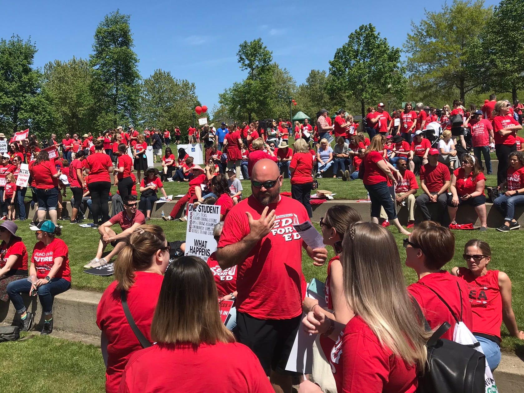 Supporters rally at Riverfront Park in Salem for education funding Tuesday, May 8, 2019.
