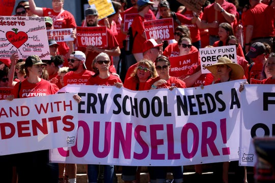 Thousands of teachers and education activists rally for school funding after they marched from Riverfront Park to the Oregon State Capitol in Salem on May 8, 2019.