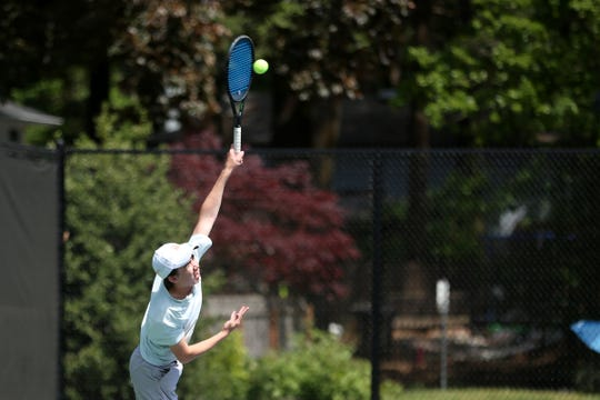 Sprague's Ben Whitson serves during the Mountain Valley Conference boys tennis championships at the Salem Tennis and Swim Club on May 7, 2019.