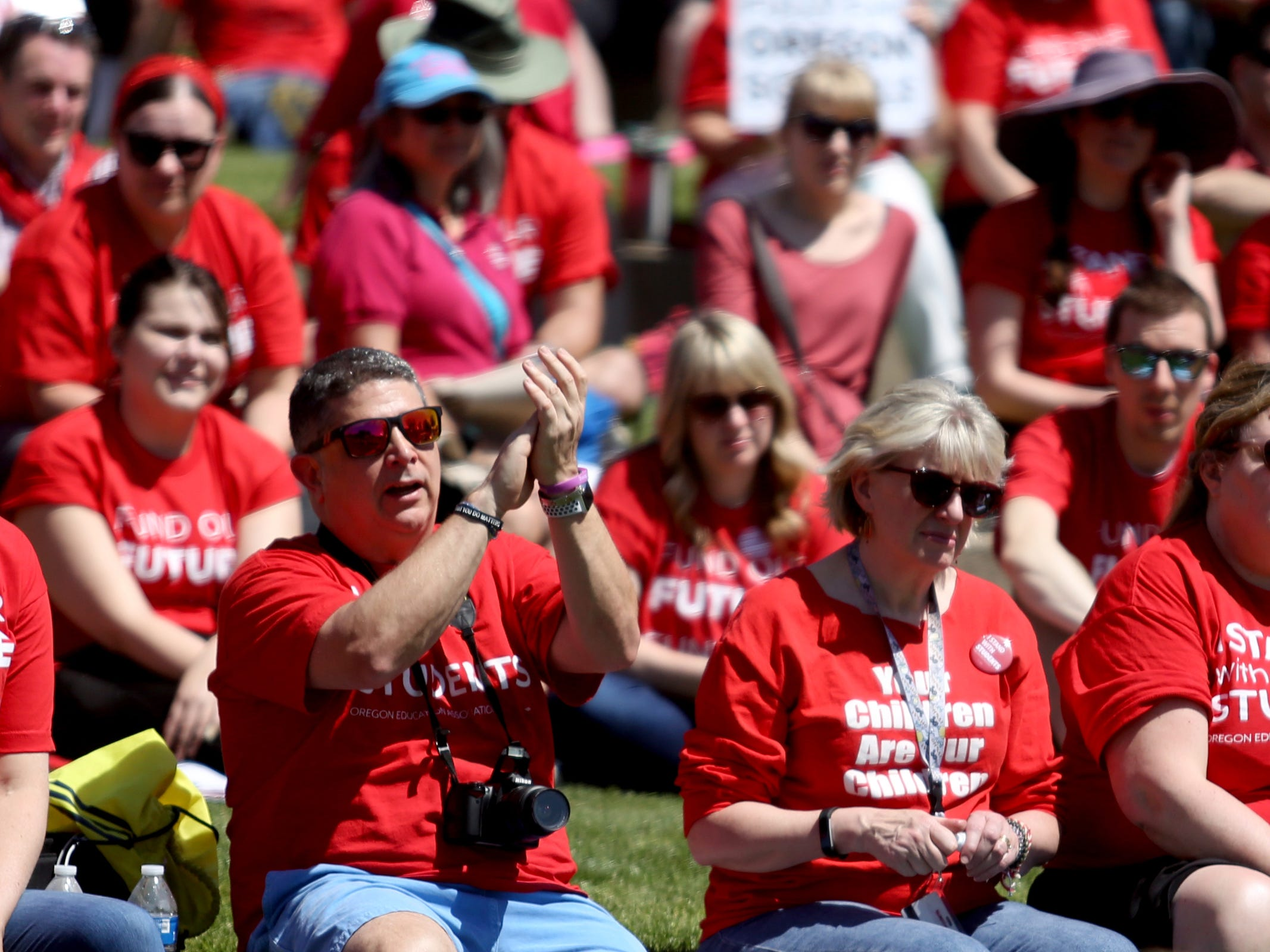 Robert Glasgow, a South Salem High School Spanish teacher cheers as thousands of teachers and education activists rally for a day of action starting at Riverfront Park in Salem on May 8, 2019. Schools across Oregon closed early or were closed for the day as teachers walked out to demand more school funding to address large class sizes, low graduation rates and other concerns.