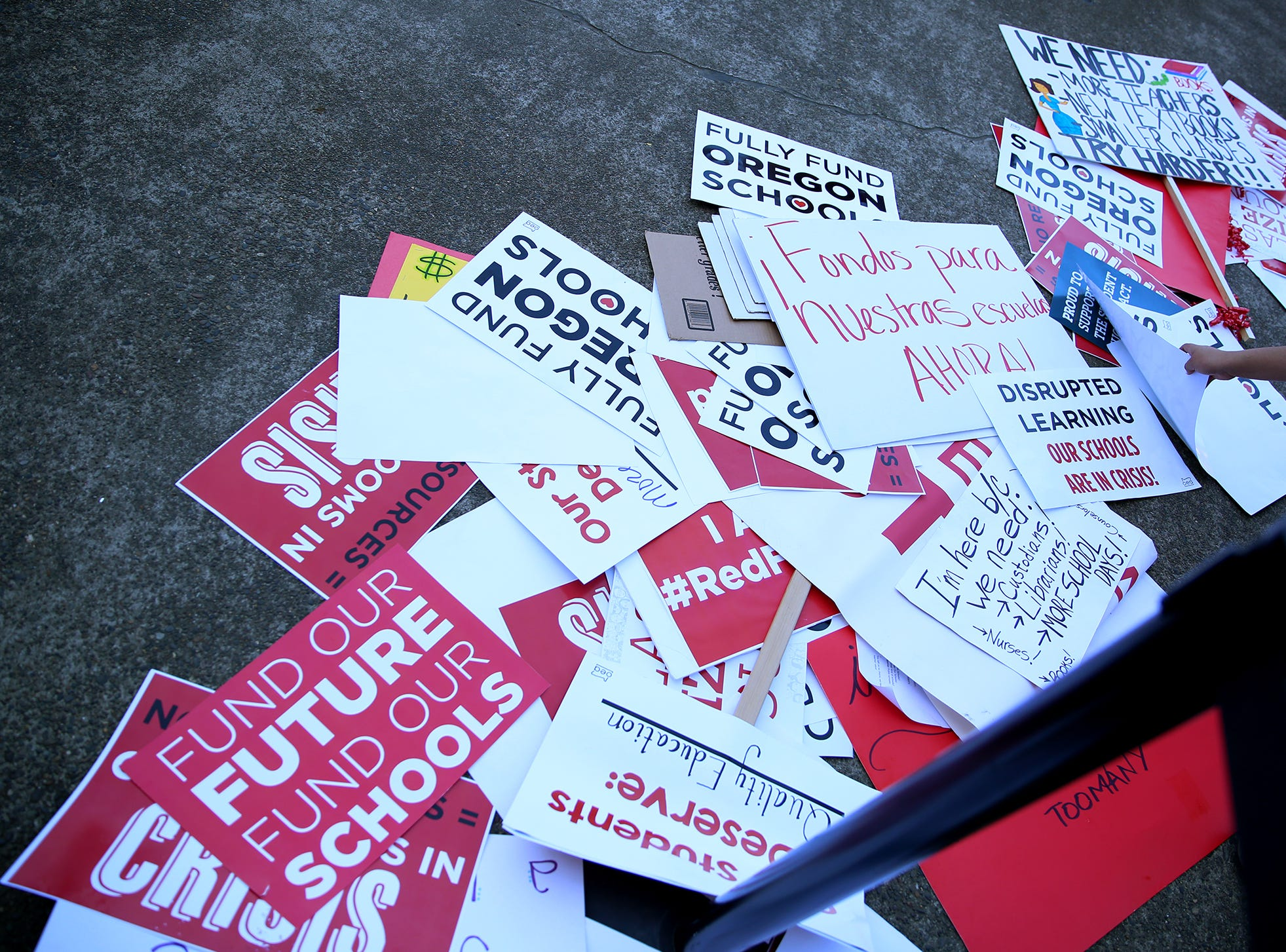 Signs are left on the steps of the Capitol during a rally for education funding where thousands of teachers and education activists marched from Riverfront Park to the Oregon State Capitol in Salem on May 8, 2019.