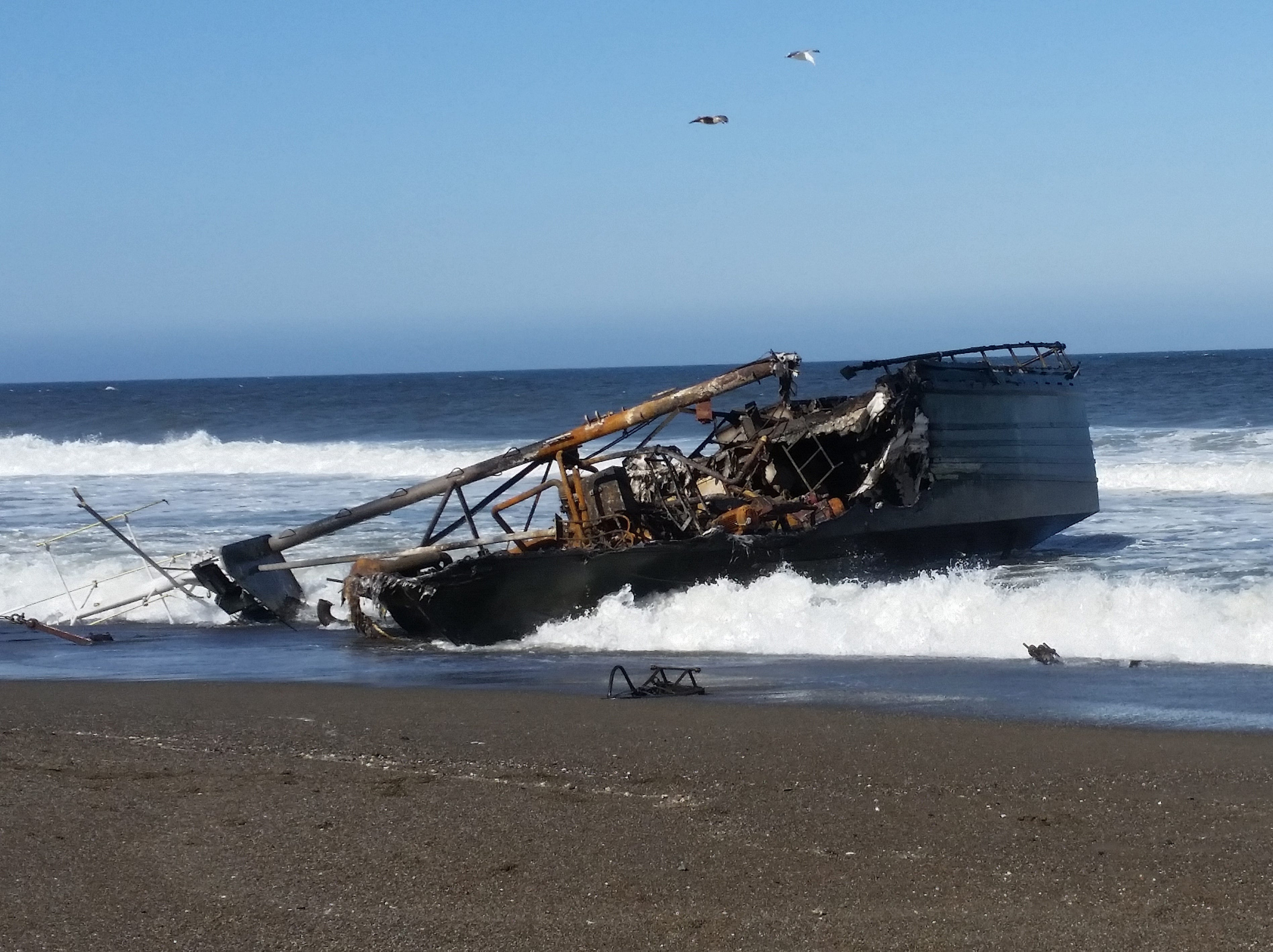 The wreckage of the 64-foot commercial fishing vessel Ann Kathleen sits on a beach near Bandon, May 5, 2019.