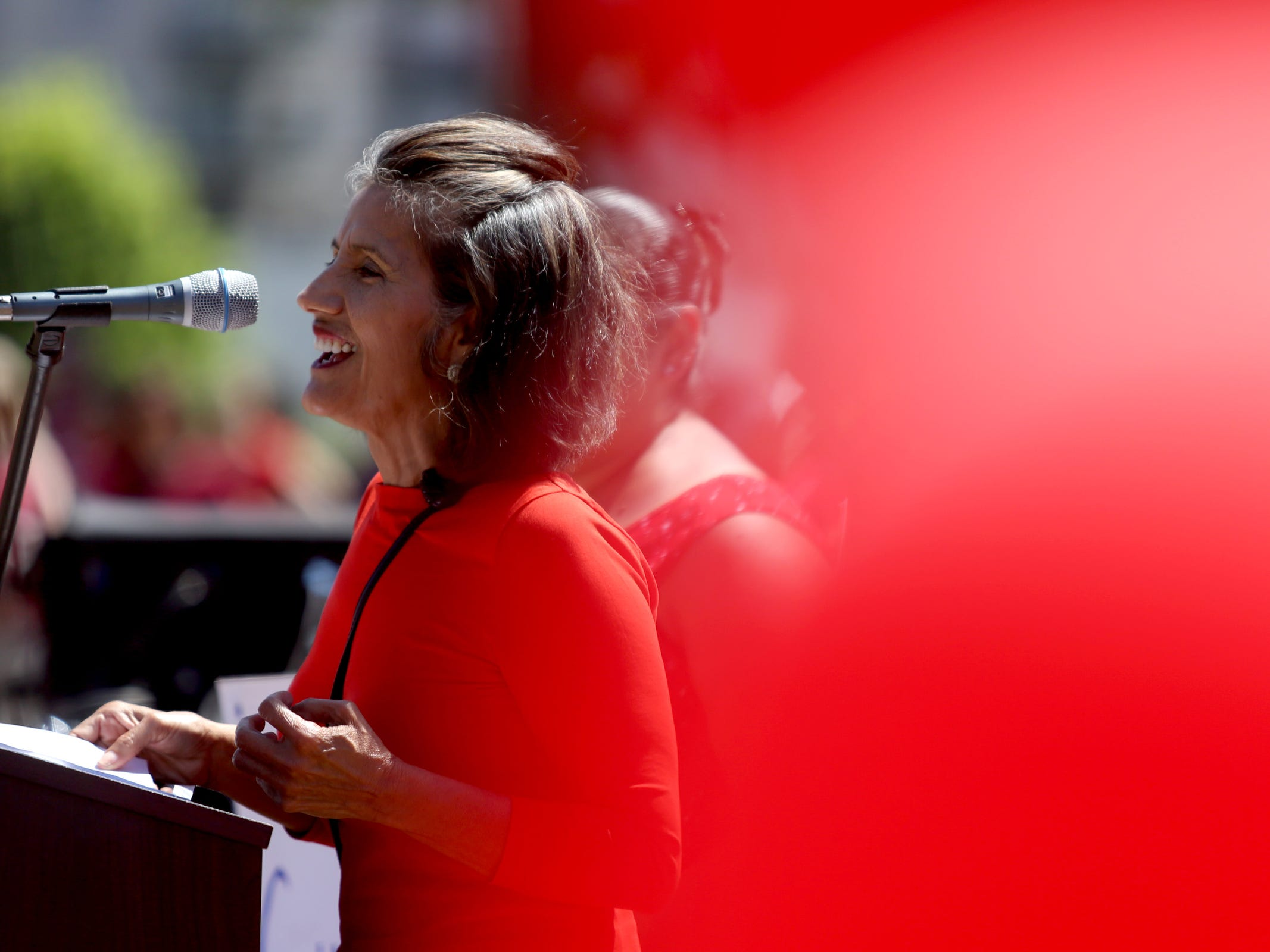 Aurora Cedillo, a retired bilingual elementary school teacher, speaks as more thousands of teachers and education activists rally for a day of action starting at Riverfront Park in Salem on May 8, 2019. Schools across Oregon closed early or were closed for the day as teachers walked out to demand more school funding to address large class sizes, low graduation rates and other concerns.