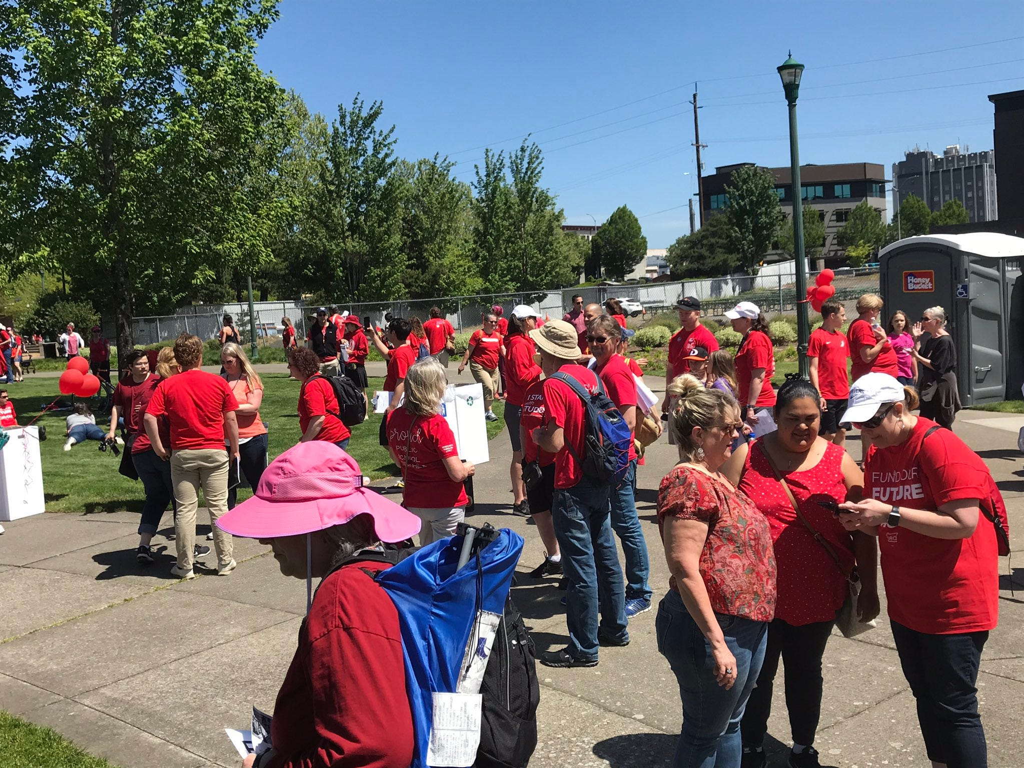 Supporters gather before the planned march to the Capitol at Salem's Riverfront Park Wednesday, May 8, 2019.