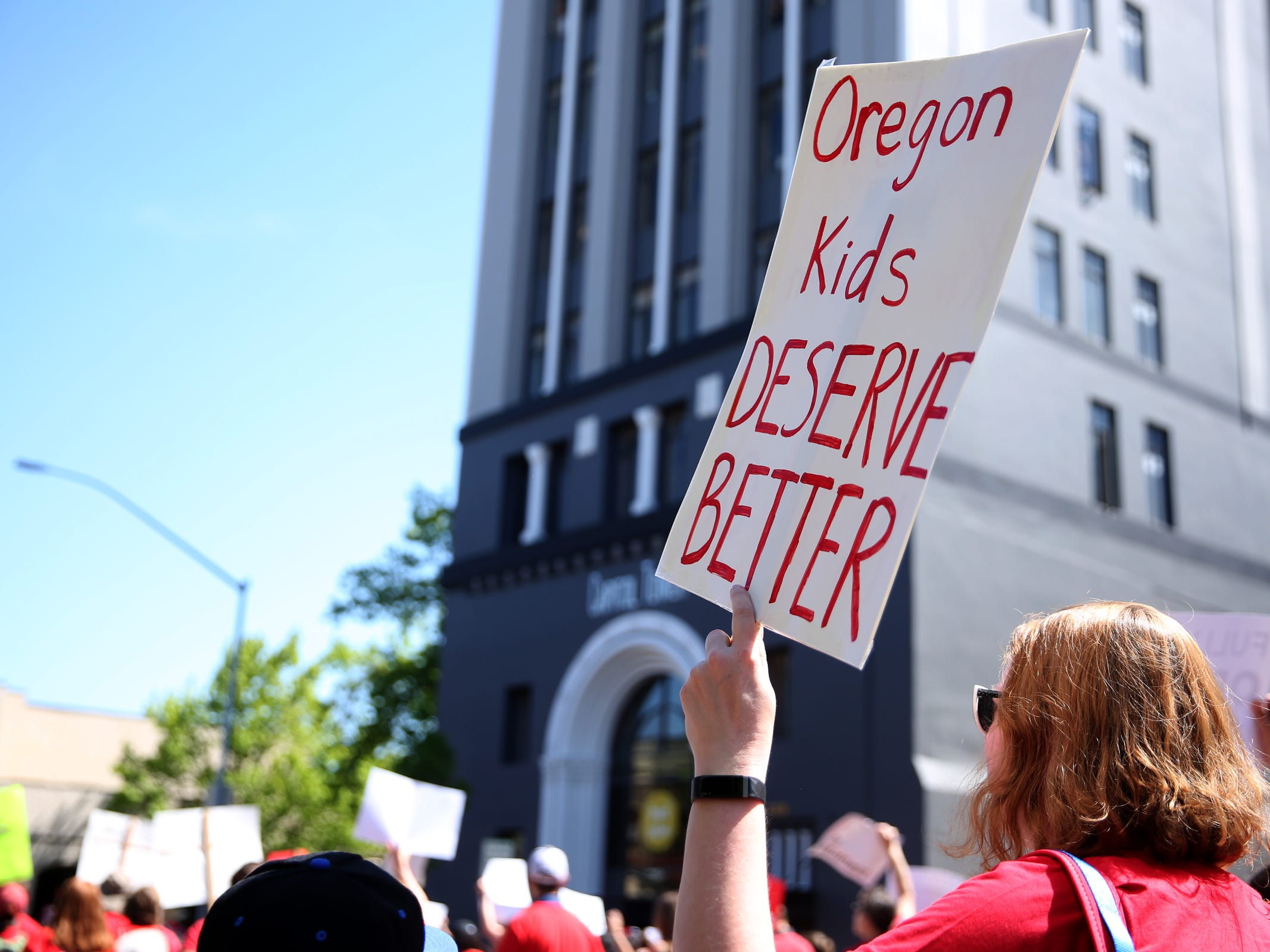 Thousands of teachers and education activists march from Riverfront Park to the Oregon State Capitol for a day of action in Salem on May 8, 2019. Schools across Oregon closed early or were closed for the day as teachers walked out to demand more school funding to address large class sizes, low graduation rates and other concerns.