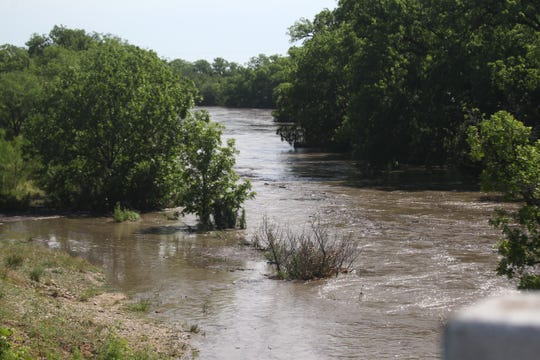 Water in Spring Creek rushing downstream from Mertzon, Texas, past Sherwood on a bridge on Farm-to-Market road 72.