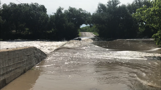 A paddle boat is about to go over Brim's Crossing on Sherwood Loop between Mertzon, Texas, and Sherwood, in Irion County. The boat was washed away from its dock up river during heavy rains in the early-morning hours of May 8, 2019.