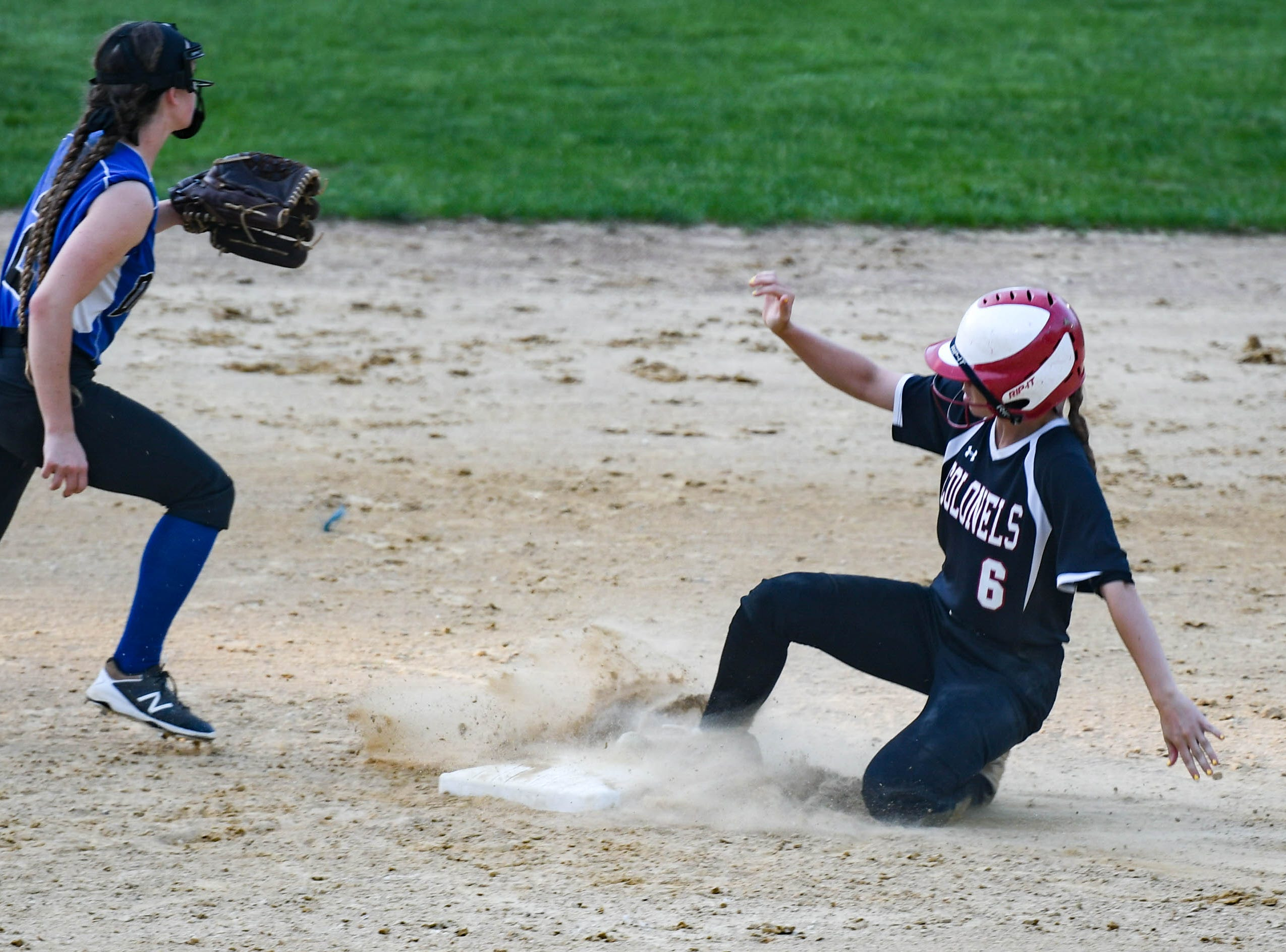 Colonel Richardson's Jen Larrimore (6) slides into second base against Decatur in the Bayside Softball Championship game on Wednesday, May 8, 2019. Decatur prevailed with a score of 4 to 1.