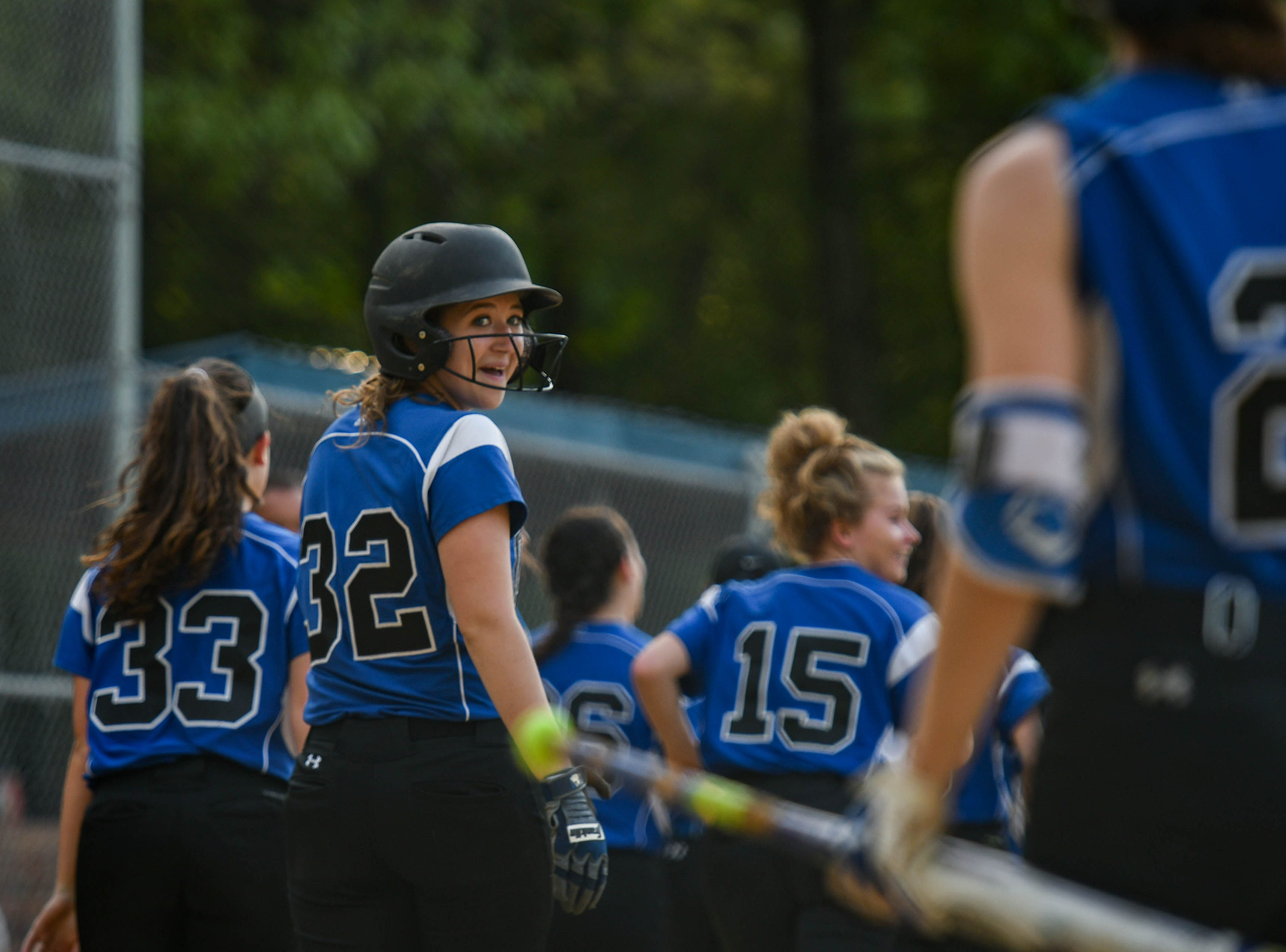 Brooklyn Pugner (32) leaves the field with the Decatur team after hitting a home run in the in the Bayside Softball Championship game against Colonel Richardson on Wednesday, May 8, 2019.