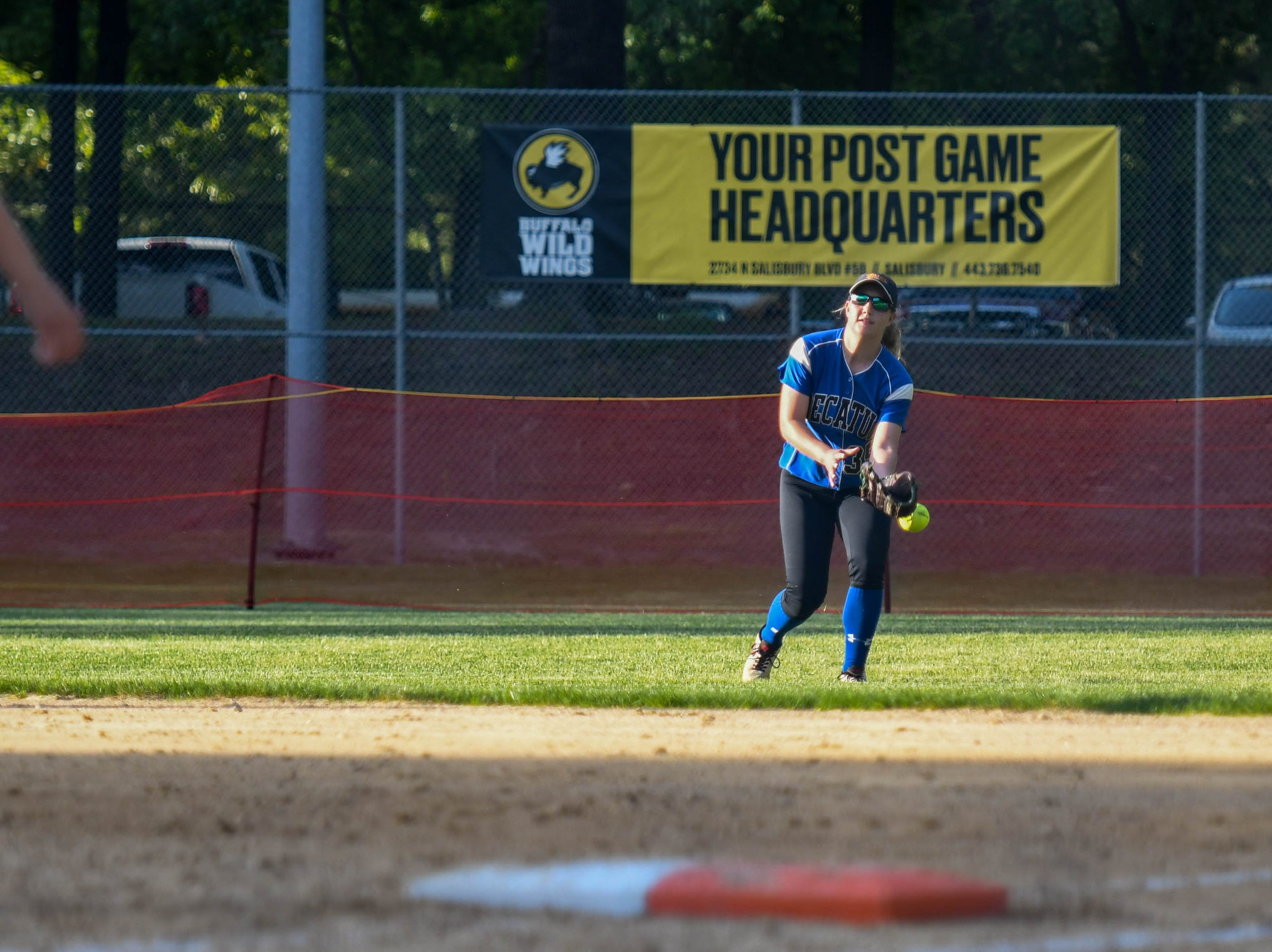 Decatur's Alexa Eisemann (35) fields a ball against Colonel Richardson in the Bayside Softball Championship game on Wednesday, May 8, 2019. Decatur prevailed with a score of 4 to 1.