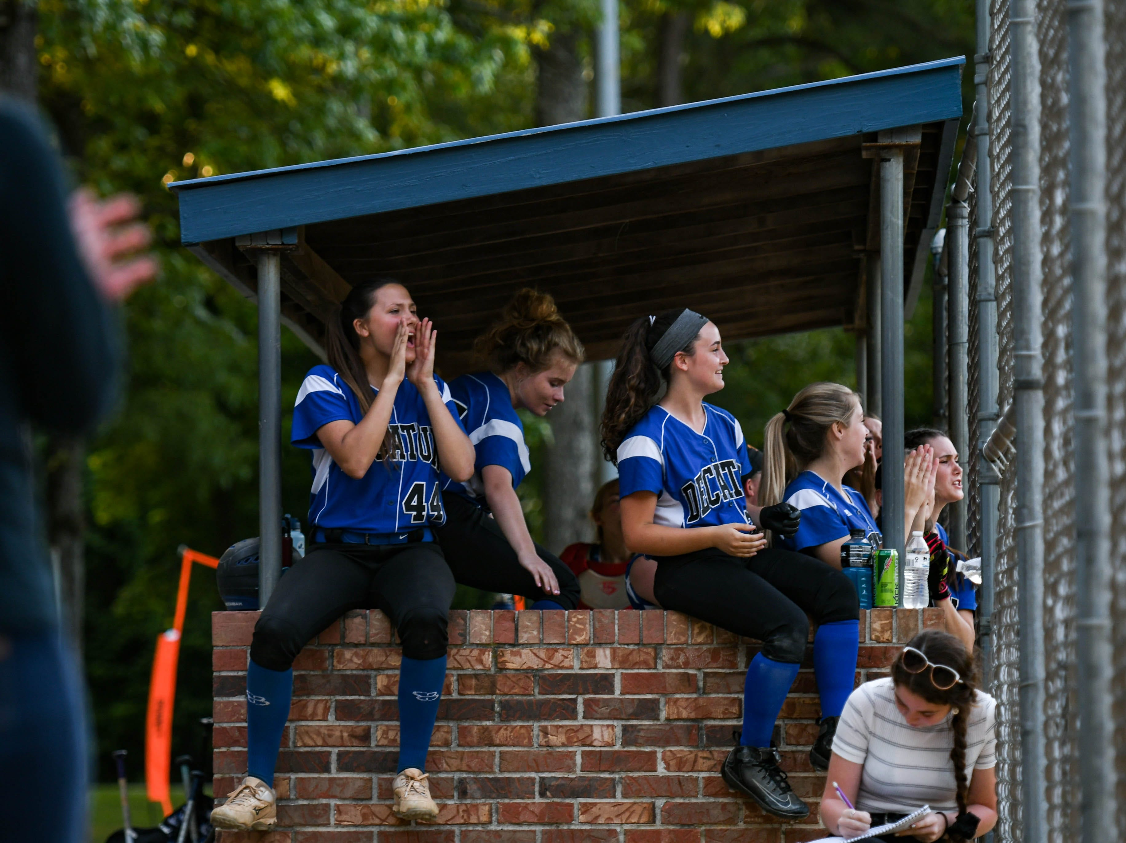 The Decatur team cheers from the dougout in the Bayside Softball Championship game against Colonel Richardson on Wednesday, May 8, 2019. Decatur prevailed with a score of 4 to 1.