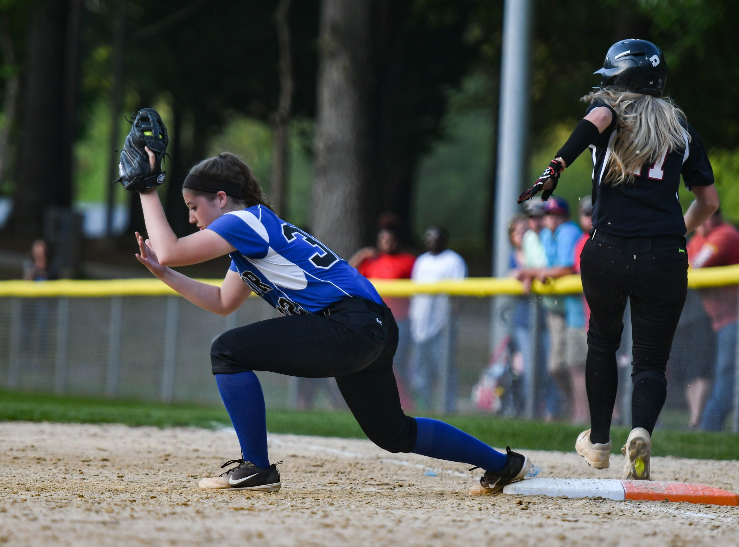 Decatur's Brooklyn Pugner (32) fields a ball against Colonel Richardson in the Bayside Softball Championship game on Wednesday, May 8, 2019. Decatur prevailed with a score of 4 to 1.