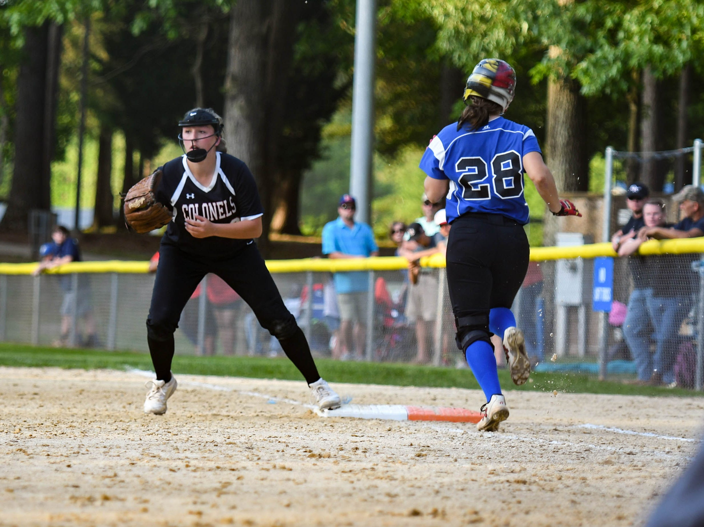 Decatur's Sierra Eisemann (28) runs for first base against Colonel Richardson in the Bayside Softball Championship game on Wednesday, May 8, 2019. Decatur prevailed with a score of 4 to 1.