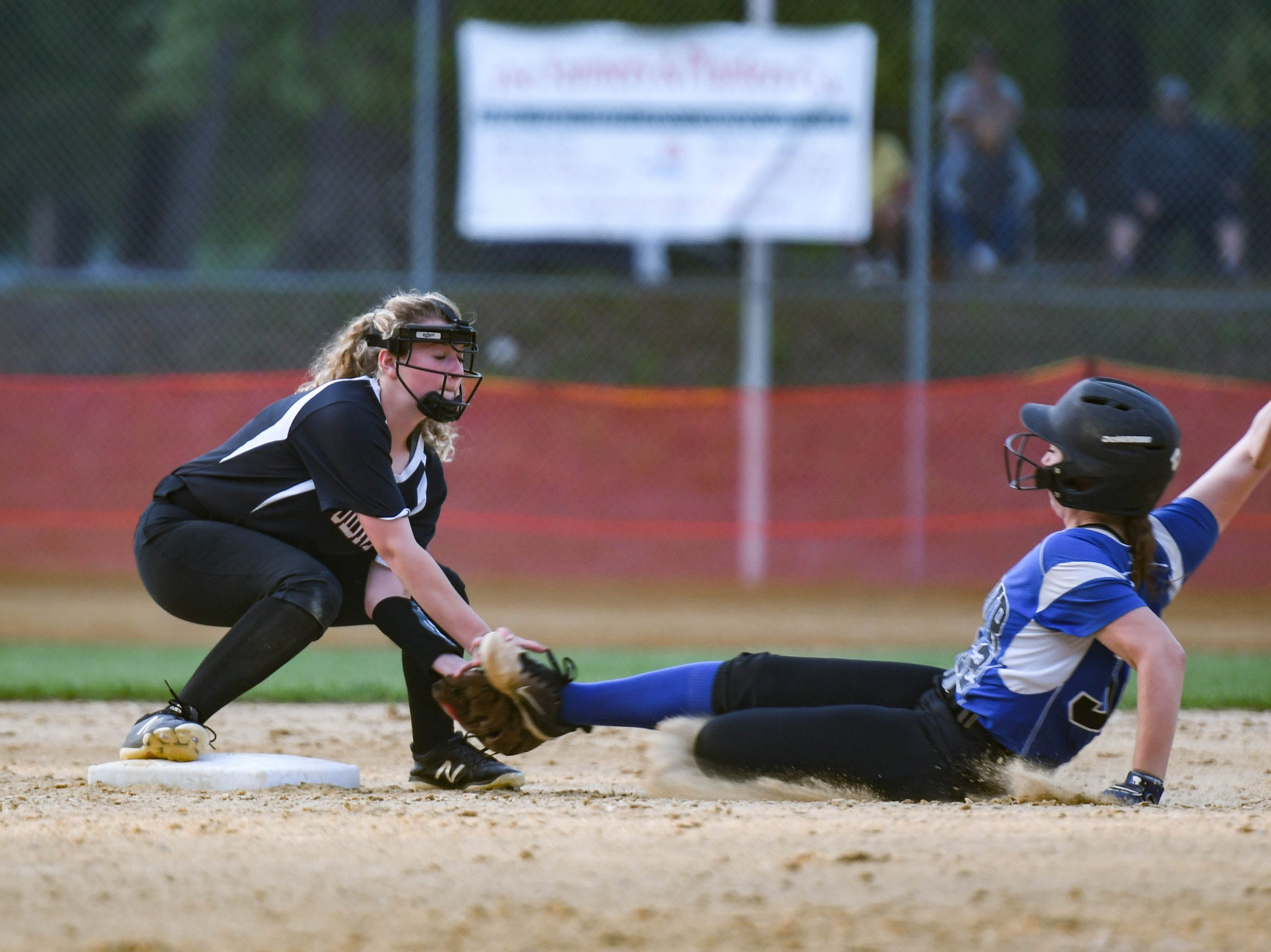 Decatur's Brooklyn Pugner (32) slides into second base in the Bayside Softball Championship game against Colonel Richardson on Wednesday, May 8, 2019. Decatur prevailed with a score of 4 to 1.