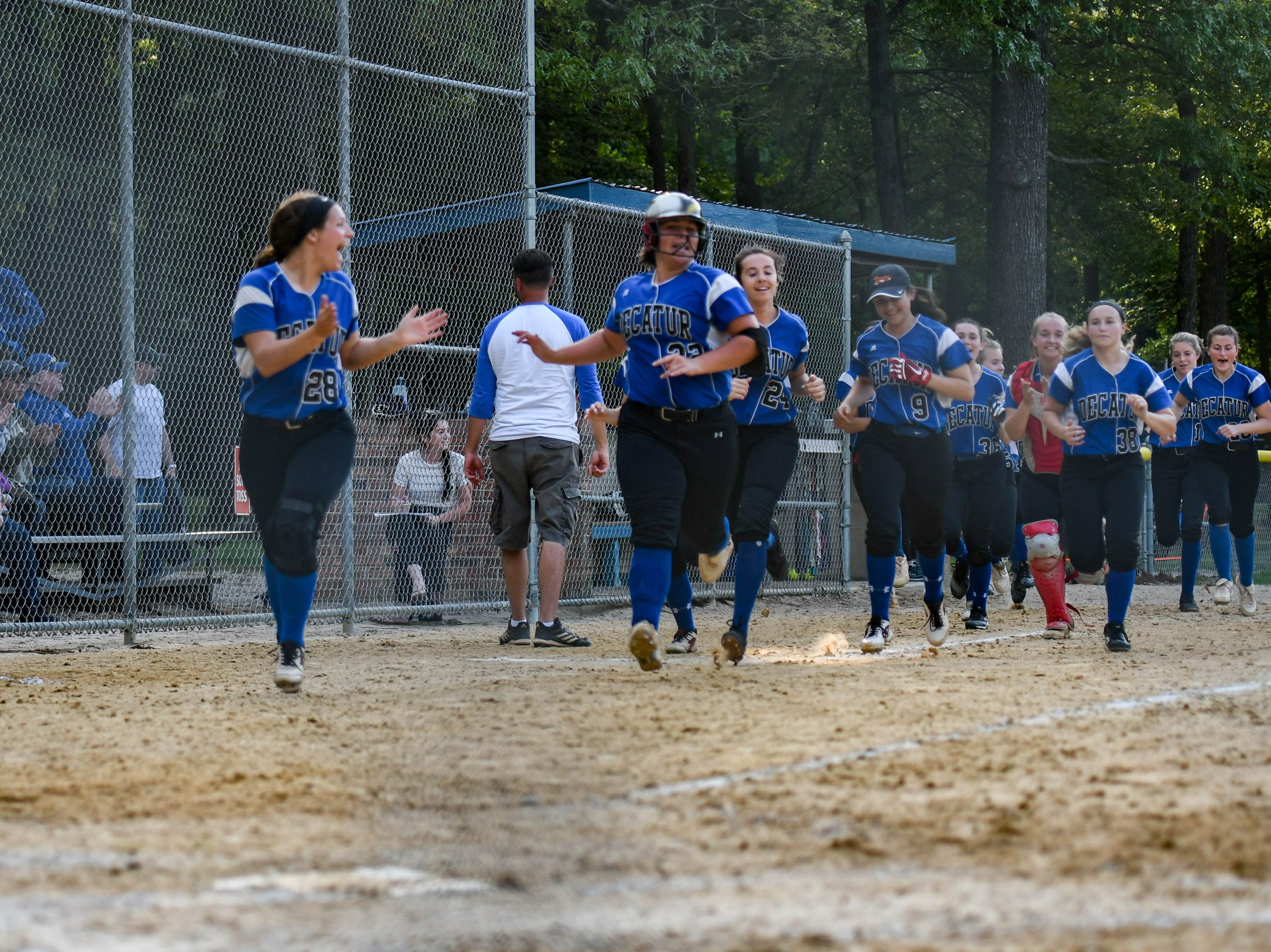 The Stephen Decatur team runs onto the field after Brooklyn Pugner hits a home run in the in the Bayside Softball Championship game against Colonel Richardson on Wednesday, May 8, 2019.