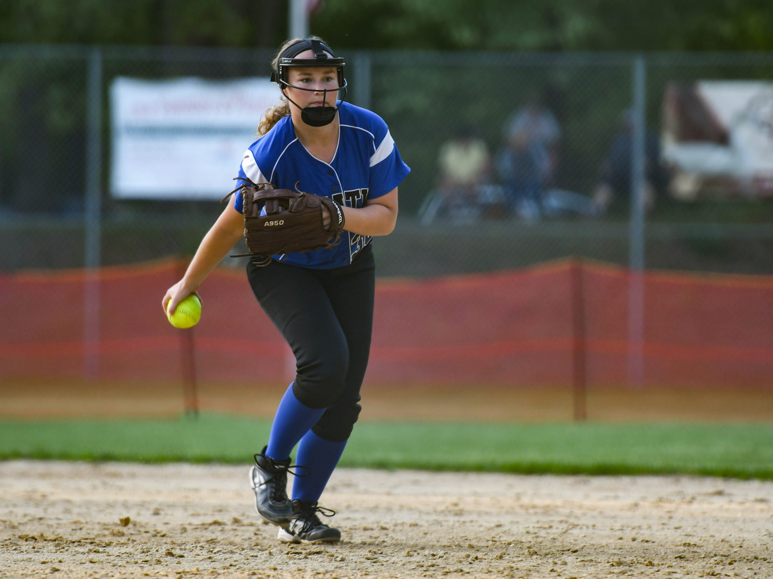 Decatur's Katie Wrench (38) fields a ball against Colonel Richardson in the Bayside Softball Championship game on Wednesday, May 8, 2019. Decatur prevailed with a score of 4 to 1.