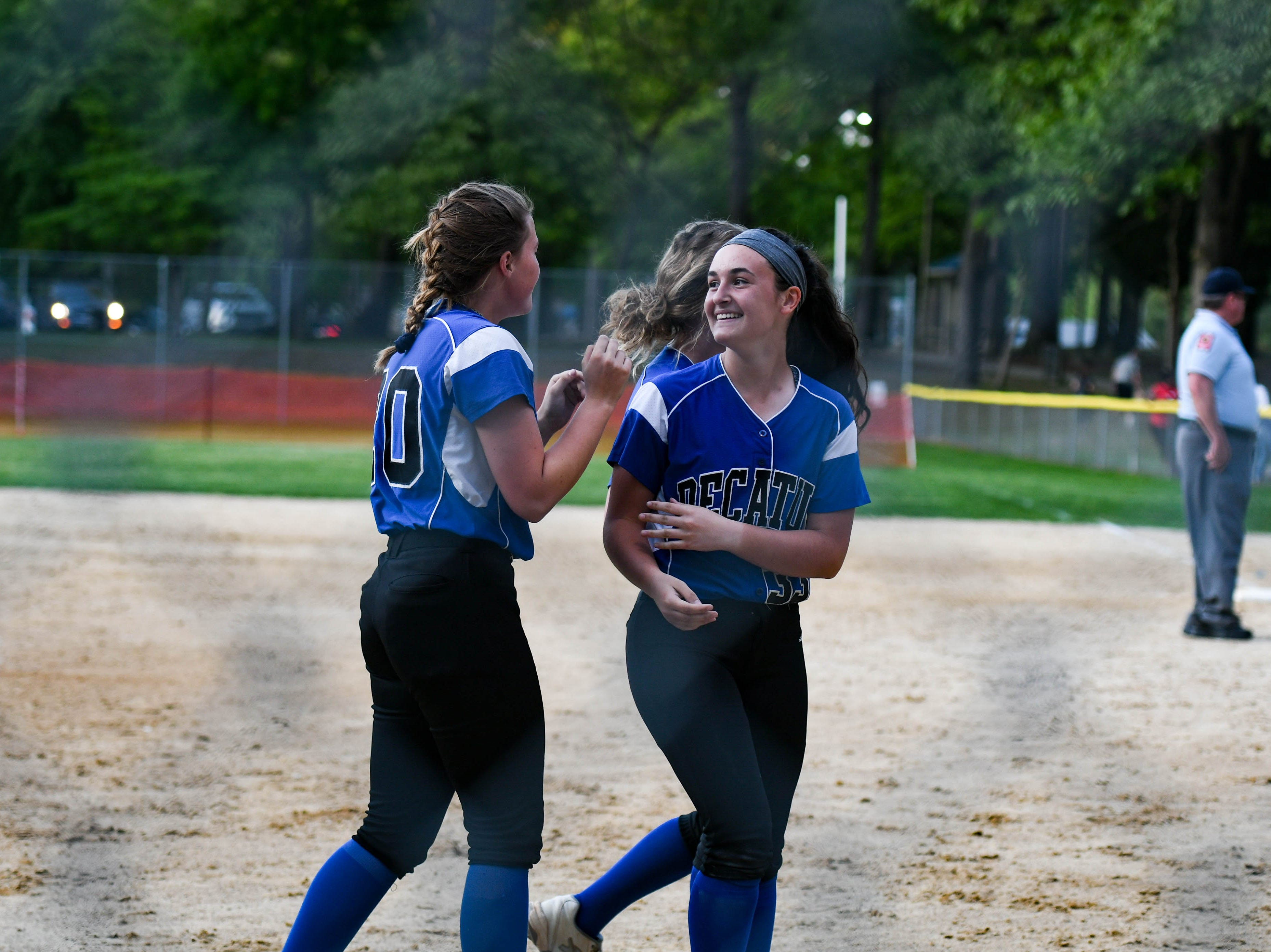 The Decatur team celebrates after winning the Bayside Softball Championship game against Colonel Richardson on Wednesday, May 8, 2019. The final score was 4 to 1.