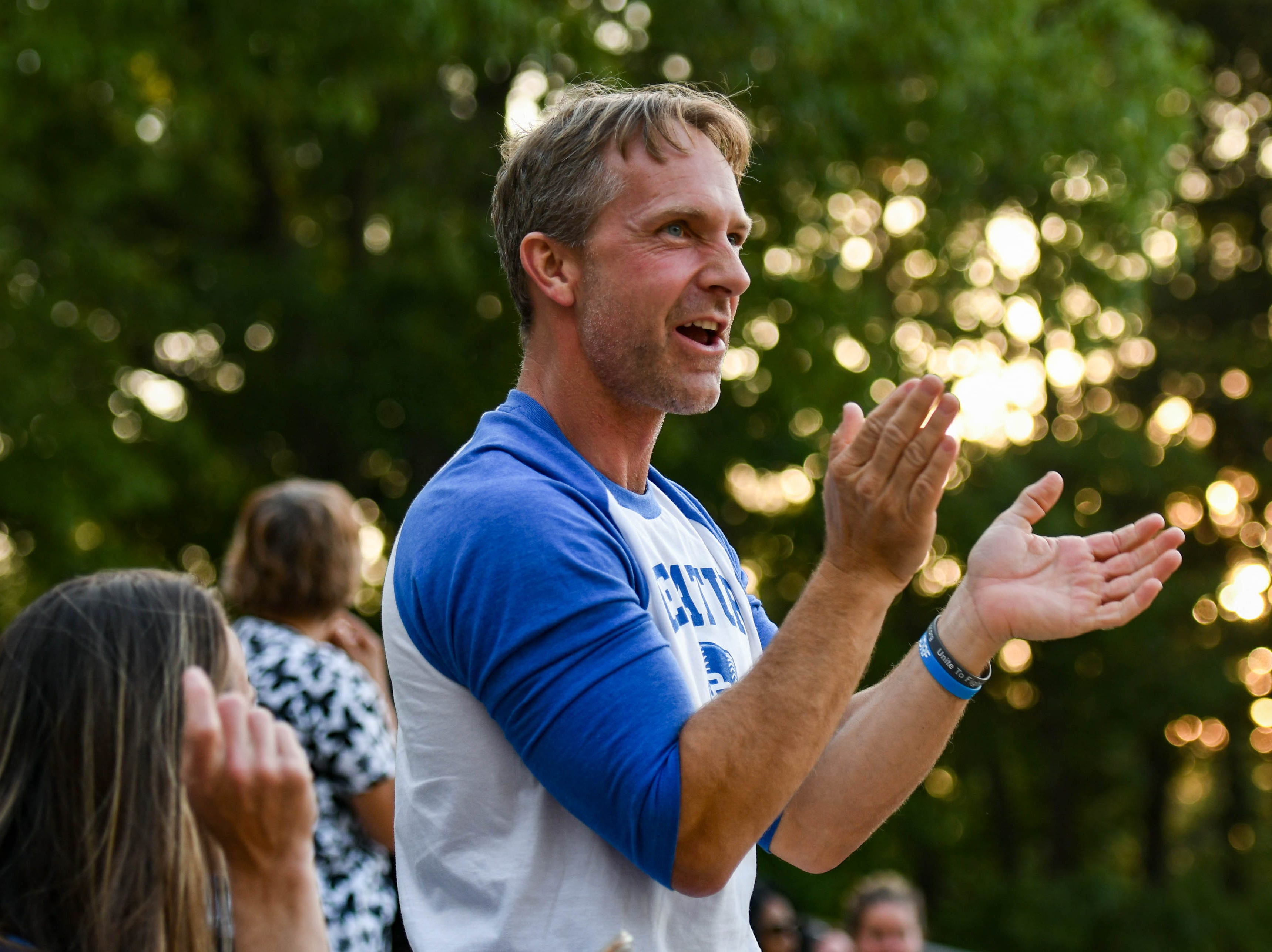 Stan Griffin cheers for his daughter's team, Stephen Decatur High School, in the Bayside Softball Championship game against Colonel Richardson on Wednesday, May 8, 2019. Decatur prevailed with a score of 4 to 1.