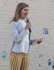 Sheboygan North student Maddie Green speaks about The Happiness Project in which she raised money to have a mural painted on the outside of the Above and Beyond Children's Museum, Tuesday, May 7, 2019, in Sheboygan, Wis.
