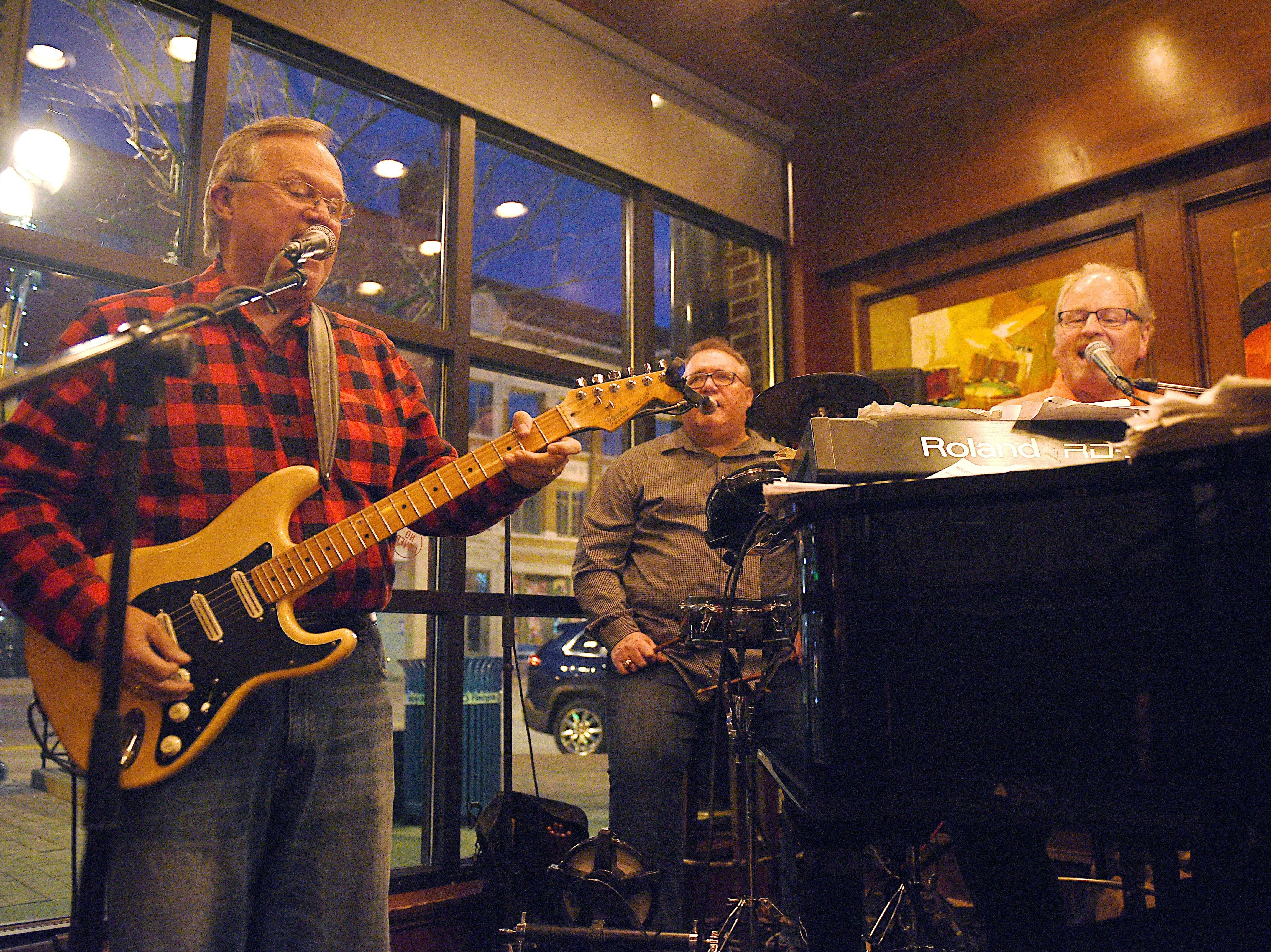 Denny Gale, Bill Hoffman and John Mogen of Mogen's Heroes perform at the Paramount Bar inside Minervas in downtown Sioux Falls on March 30, 2018.
