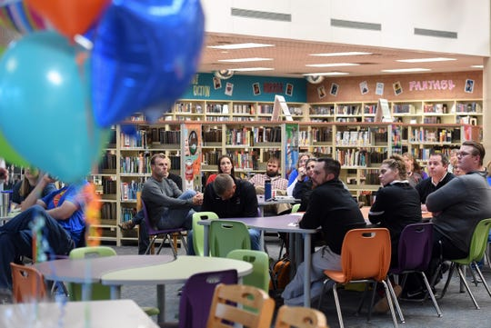 Teachers wait to hear the winners of the Innovation in Education grants from the Sioux Falls Public Schools Education Foundation on Wednesday, May 8, 2019 at Washington High School.