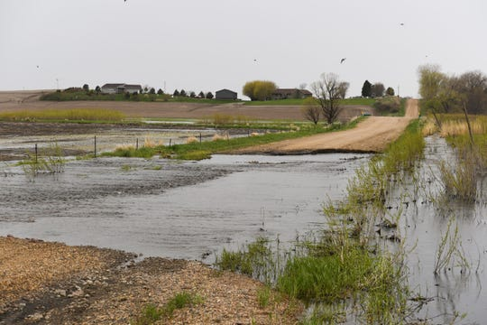 Flooding closes a road in Crooks, South Dakota on Tuesday, May 7. Roads like this make it difficult for the local fire department to reach emergency sites in a timely manner.
