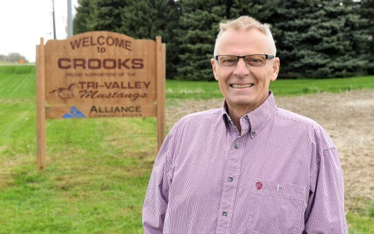 """Francis """"Butch"""" Oseby stands at the entrance of Crooks, South Dakota, on Tuesday, May 7. Oseby will be sworn in as mayor of Crooks on Monday, May 13 after an unconventional path to victory."""