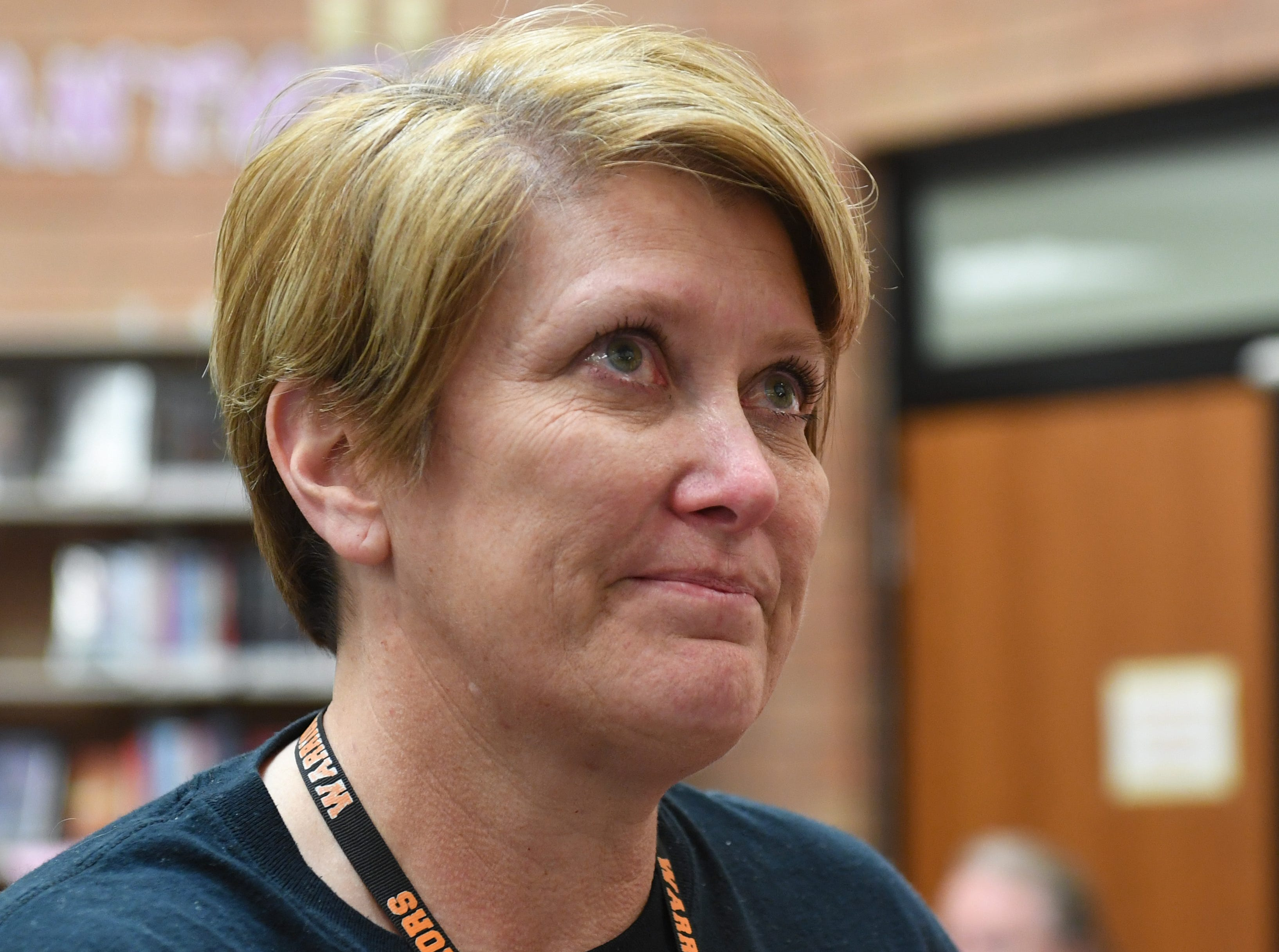 Washington High teacher Britt Samson blinks tears from her eyes as she expresses her gratitude after receiving an Innovation in Education grant from the Sioux Falls Public Schools Education Foundation on Wednesday, May 8, 2019 in the Washington High School library. The grant will be put toward virtual reality equipment to allow her students to travel the world regardless of income.