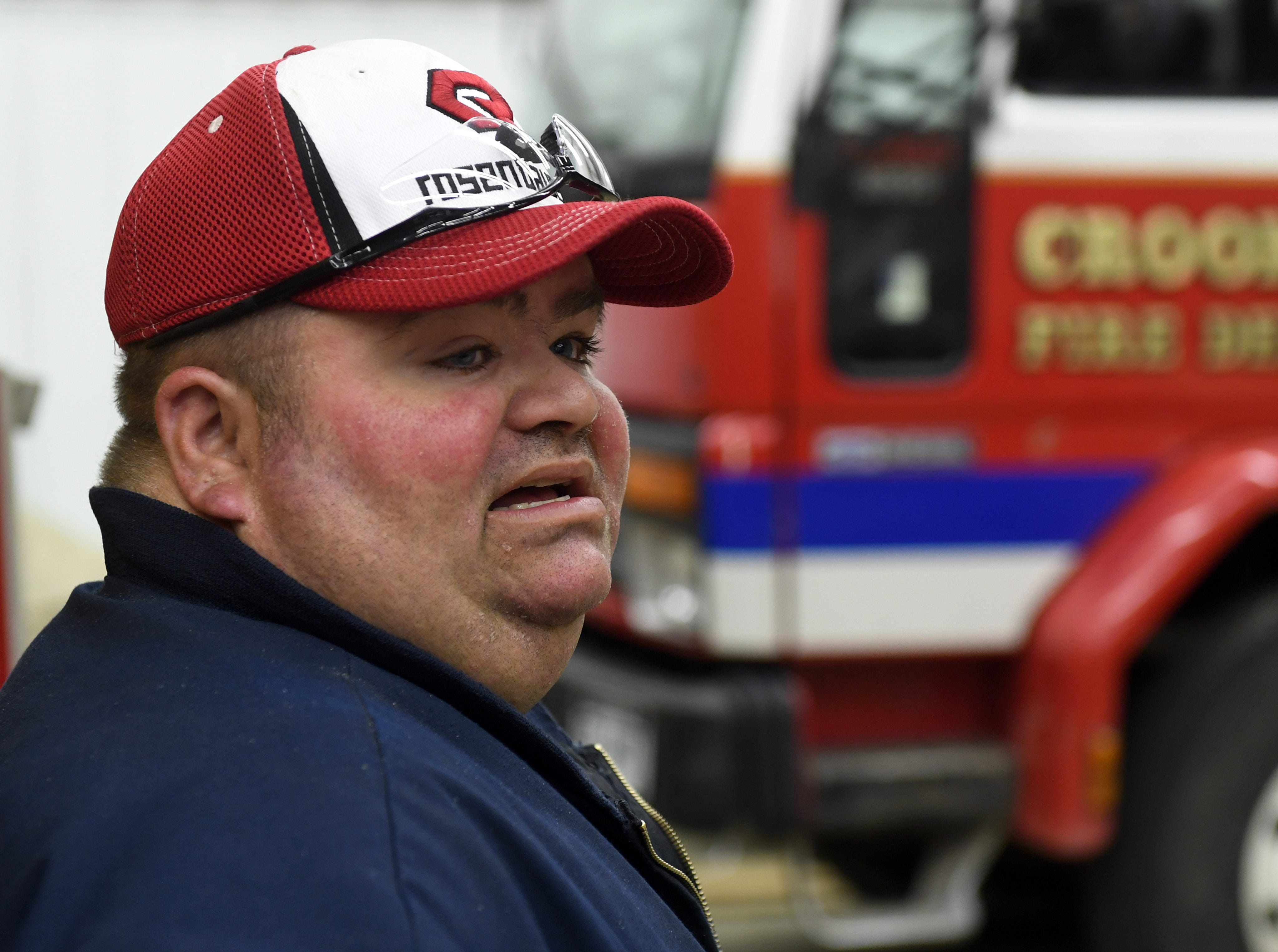 Steve Boer, volunteer firefighter, describes the operations of a rural fire department in the equipment garage Tuesday, May 7, in Crooks. Boer volunteers for the departments in both Crooks and Lyons, where many residents' homes can be difficult to access.