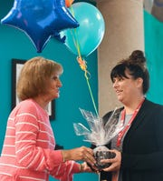 Sharon Schueler, grants committee chairwoman for the Sioux Falls Public Schools Education Foundation, presents English Teacher Meghan Wounded Head with a balloon bouquet as Wounded Head wins an Innovation in Education grant Wednesday, May 8, 2019 at Washington High School.