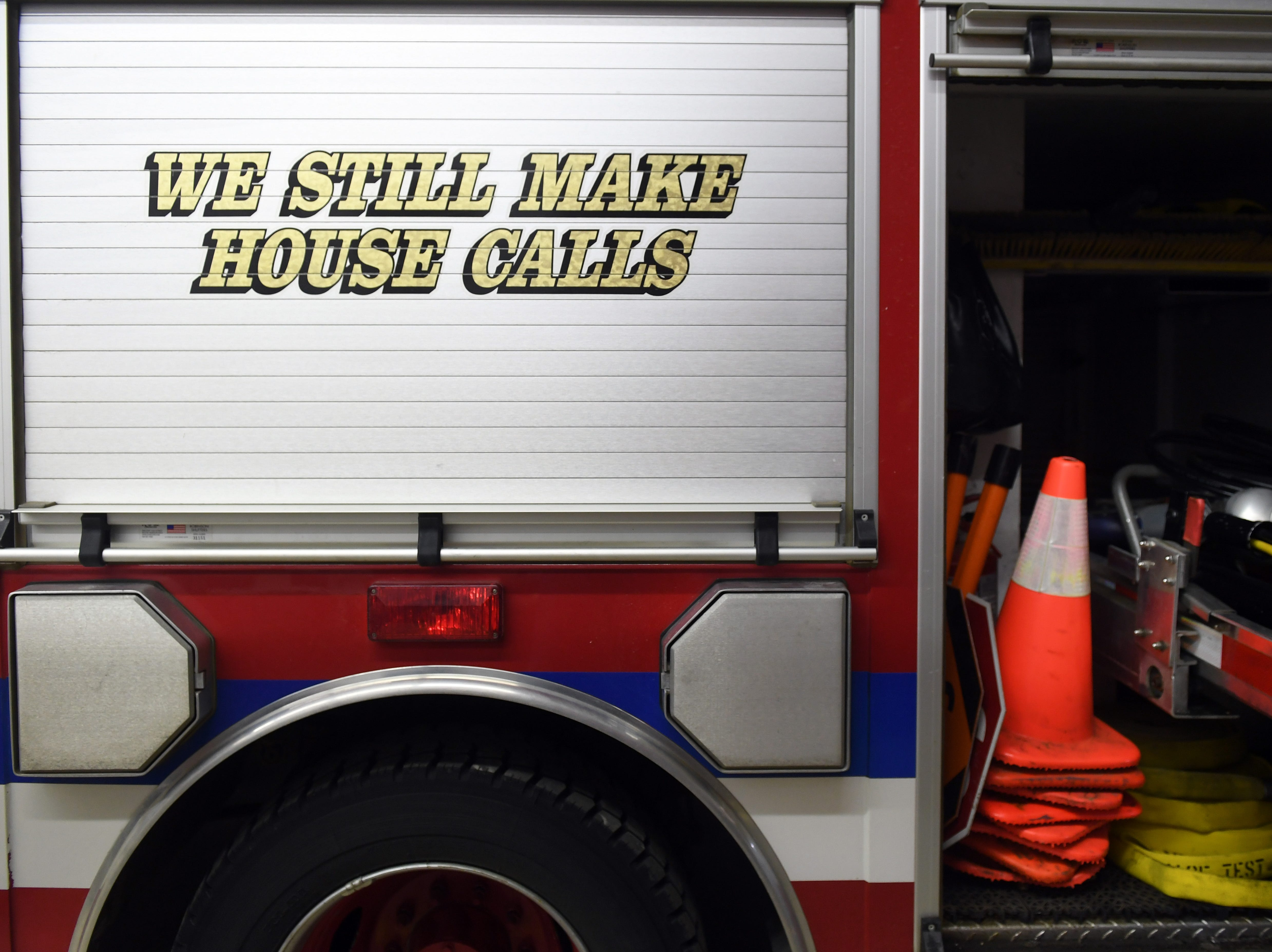 "The phrase ""we still make house calls"" is displayed on a truck Tuesday, May 7, at the Crooks Fire Department. Volunteer firefighter Steve Boer said they often respond to emergency calls down long dirt roads away from town, but that recent flooding has rendered many of those paths inaccessible."