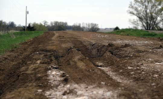 Consequences of early spring flooding interrupt rural roads in Crooks, South Dakota on Tuesday, May 7. Local volunteer fire departments have difficulties responding to calls on these roads because their trucks cannot safely navigate the soft, unstable dirt.