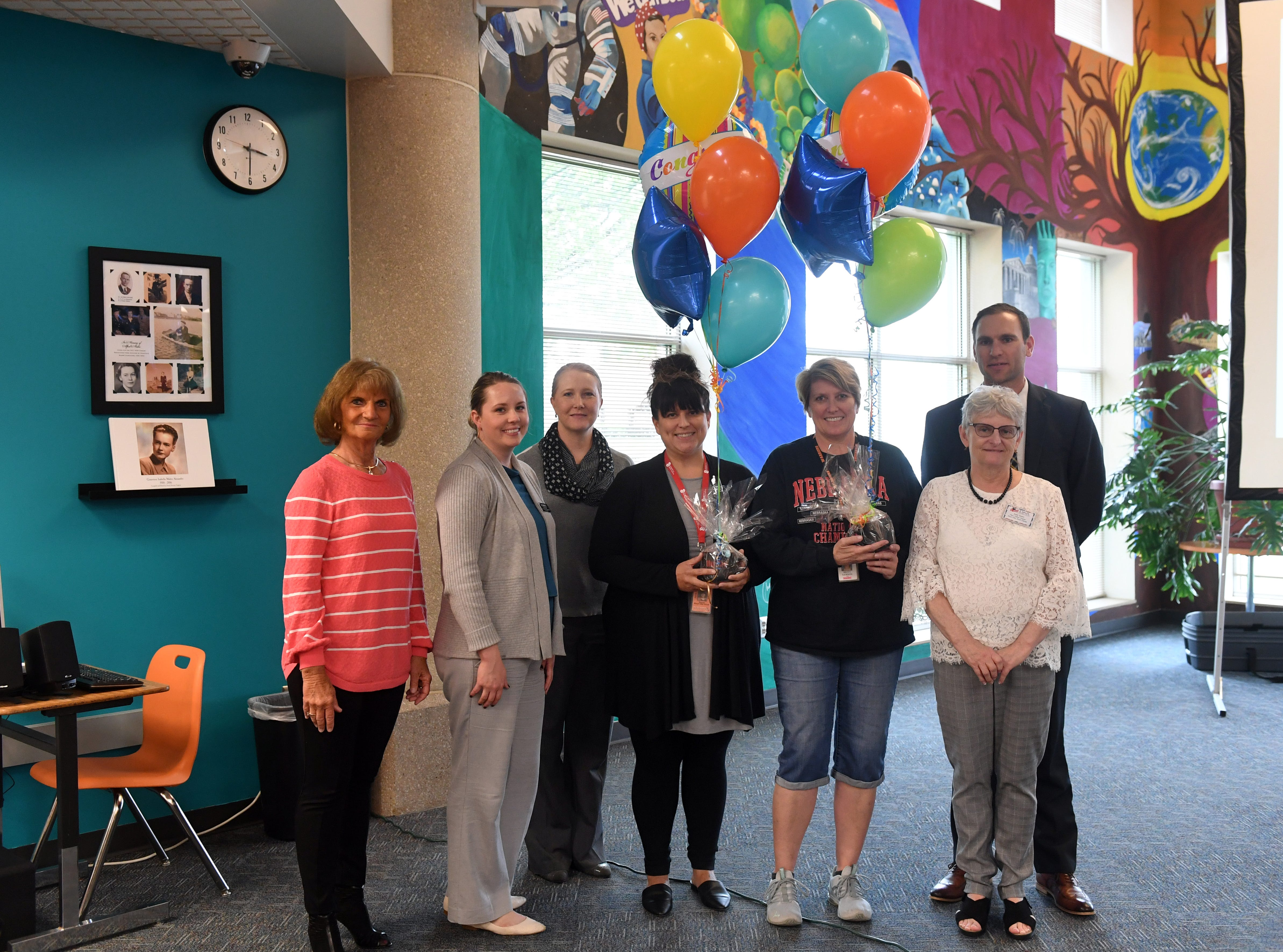 Members of the grants committee and Sioux Falls School District gather around grant winners Meghan WoundedHead and Britt Samson, center, after surprising them with the news that they won Wednesday, May 8, at Washington High School.