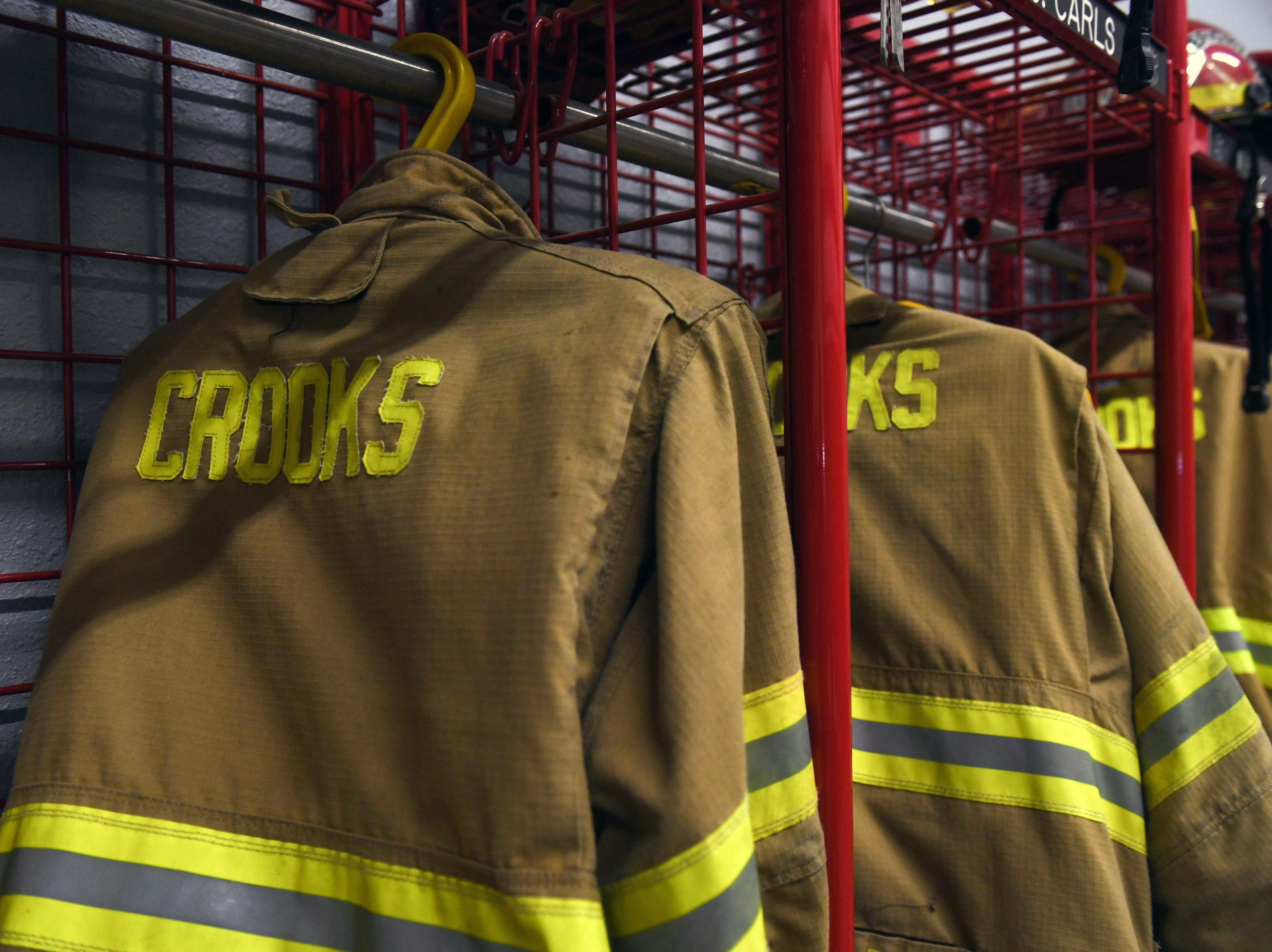 Gear for the volunteer firefighters hangs in cubbies at the Crooks Fire Department on Tuesday, May 7. Volunteers do not work in shifts at the department, but respond to calls from wherever they are throughout the day.