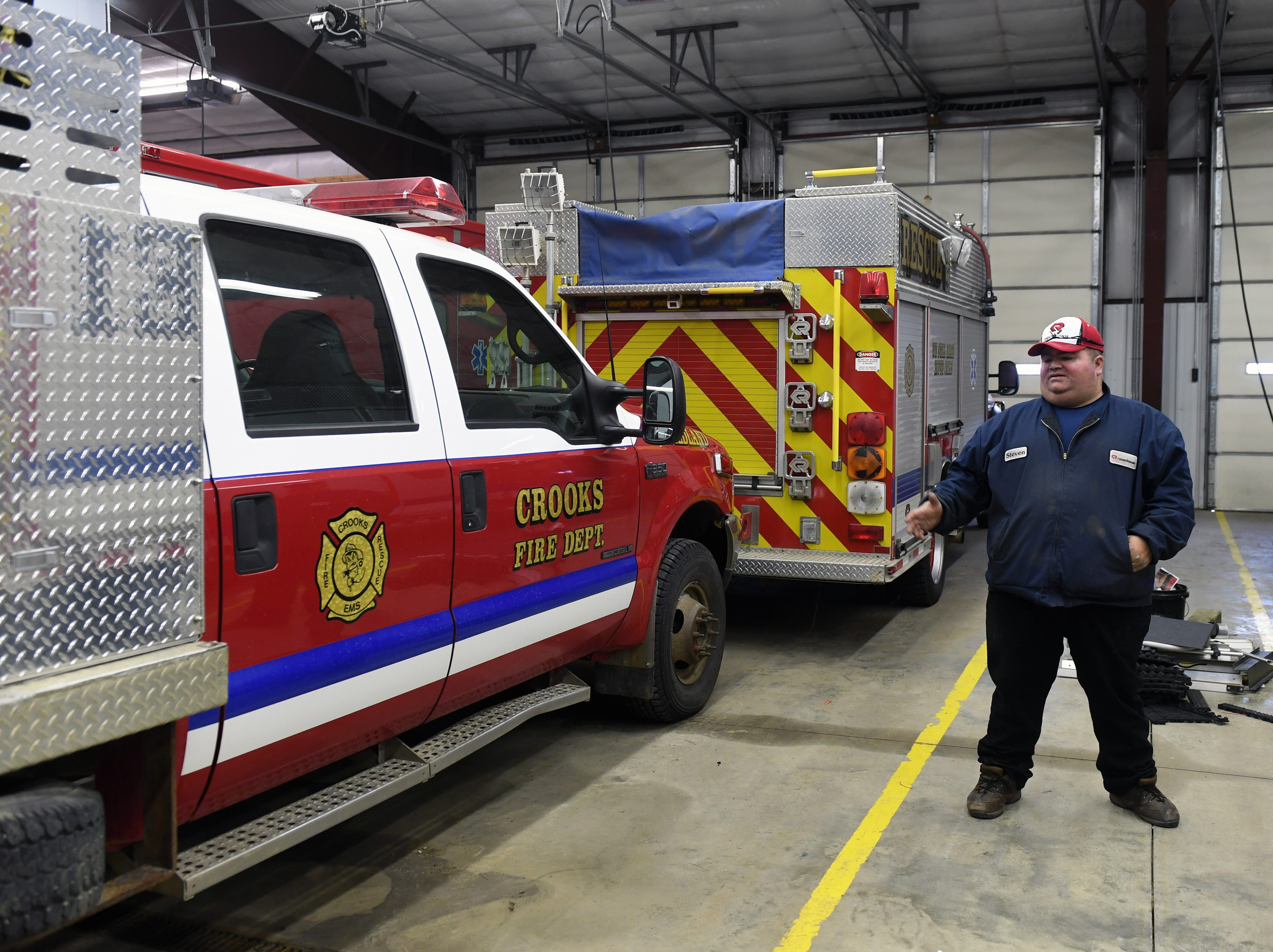 Volunteer firefighter Steve Boer describes the equipment available to the Crooks Fire Department on Tuesday, May 7. Even though their equipment is in good condition, roads can often be damaged too much for even their largest trucks to get through.