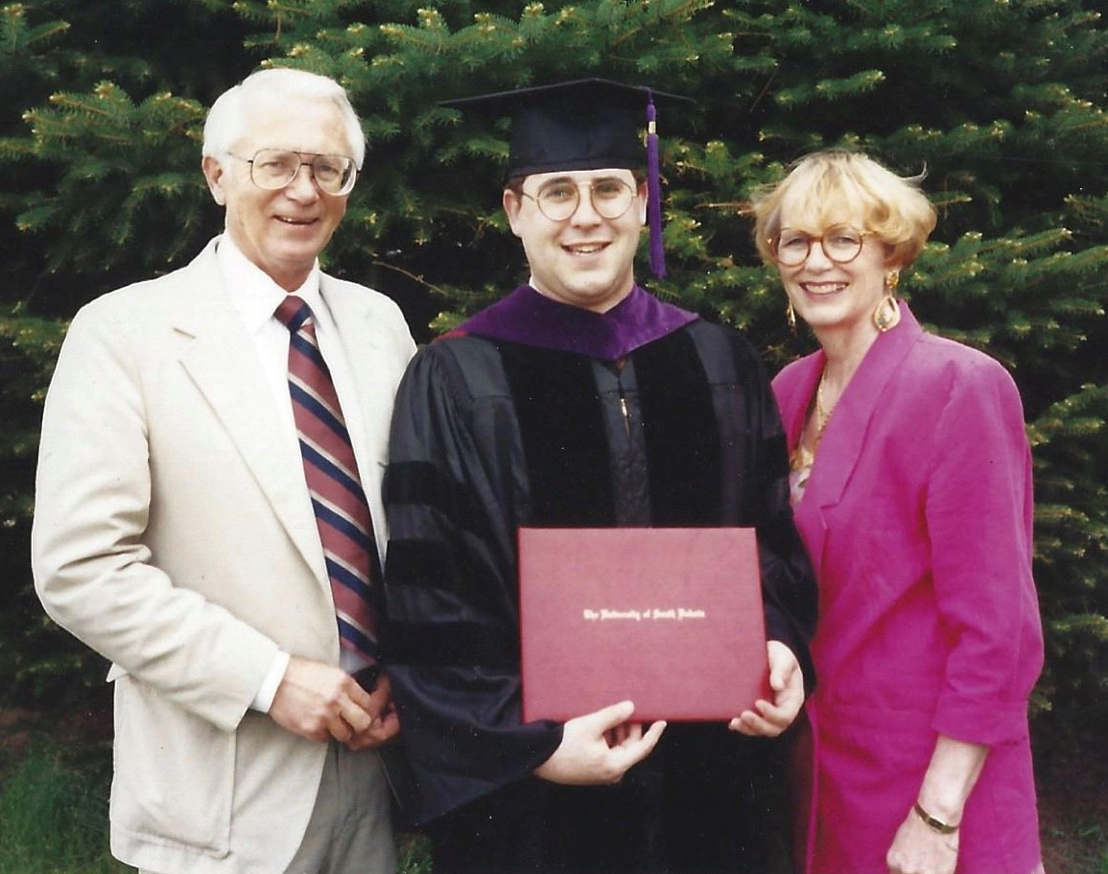 Jason Harris graduated from law school at USD in 1993, surrounded by his adoptive parents Russell and Mary Anne.