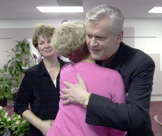 Todd Schaible gets a hug at a 2001 retirement party at Burrell Behavioral Health Center.