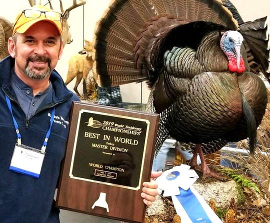 Harold McGuire displays his turkey mount and best-in-world award at the Taxidermy World Championships Friday, May 3, in Springfield, Missouri.