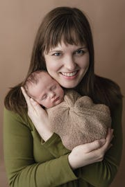 Reporter Nora Hertel with her baby, Jude Decker, about three weeks after his March 2019 birth.