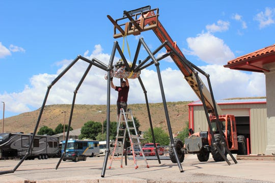 The giant spider sculpture is secured  before being hoisted into its final location, Wednesday, May 8, 2019.