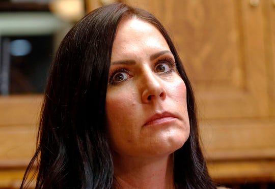 Brenda Mayes speaks during a news conference Tuesday, May 7, 2019, in Salt Lake City. Mayes, a mother sued Utah school administrators, alleging that a school bus driver trapped her older son's backpack in the door and drove away in a racially motivated event. (AP Photo/Rick Bowmer)