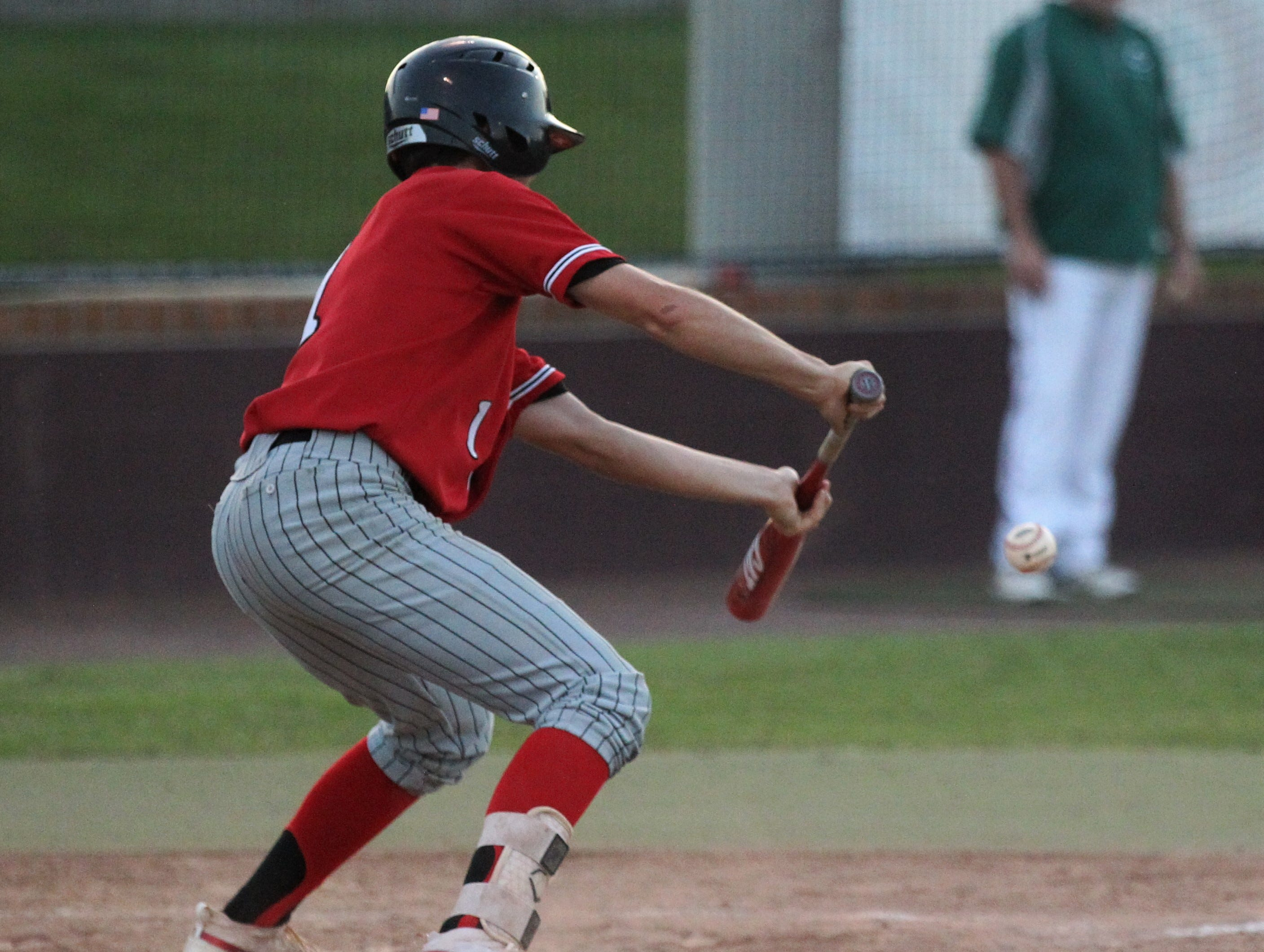 Leon junior Garrett Green tries to bunt his way on base as Chiles beat Leon 10-6 during a District 2-8A semifinal on May 7, 2019.