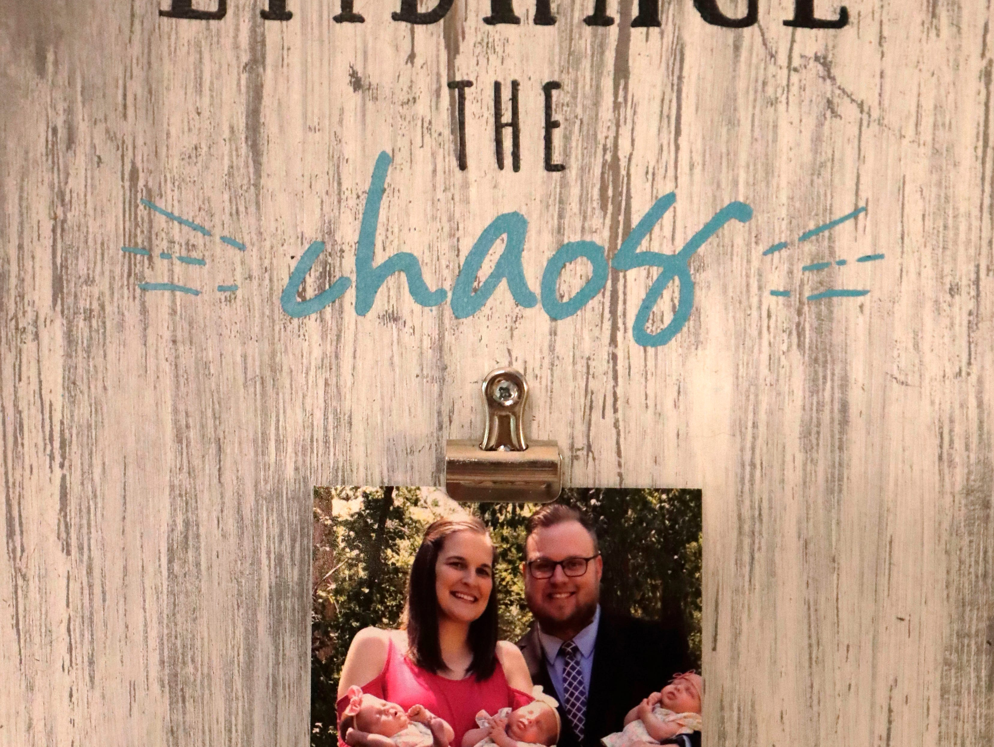 Megan Walker, a new mom to triplets, made a home decor picture holder which is a good representation of her family's new life Tuesday, May 8, 2019.