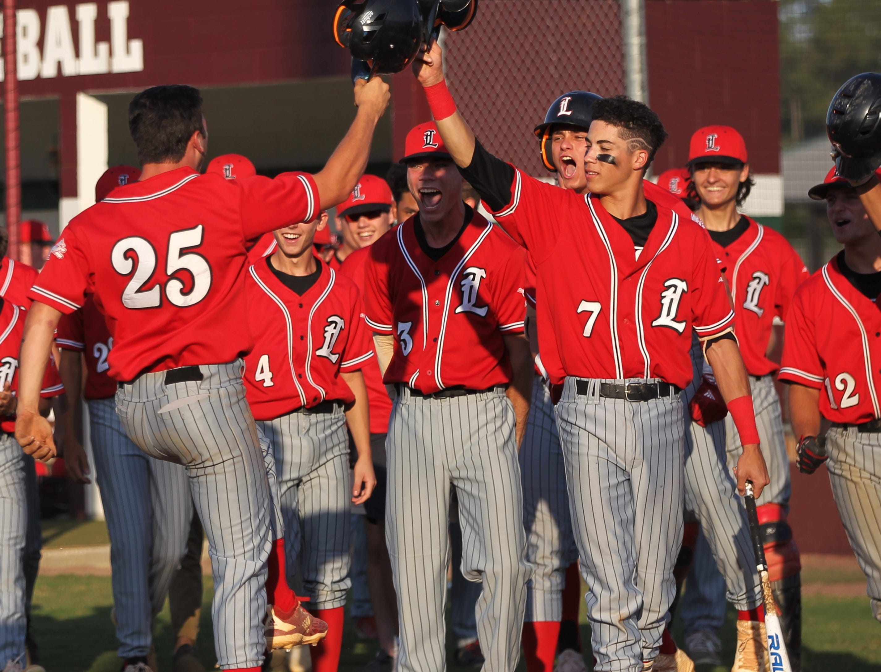 Leon senior Tyler Borges (25) celebrates his home run with True Fontenot (7), Matt Sims (3) and the rest of his teammates as Chiles beat Leon 10-6 during a District 2-8A semifinal on May 7, 2019.