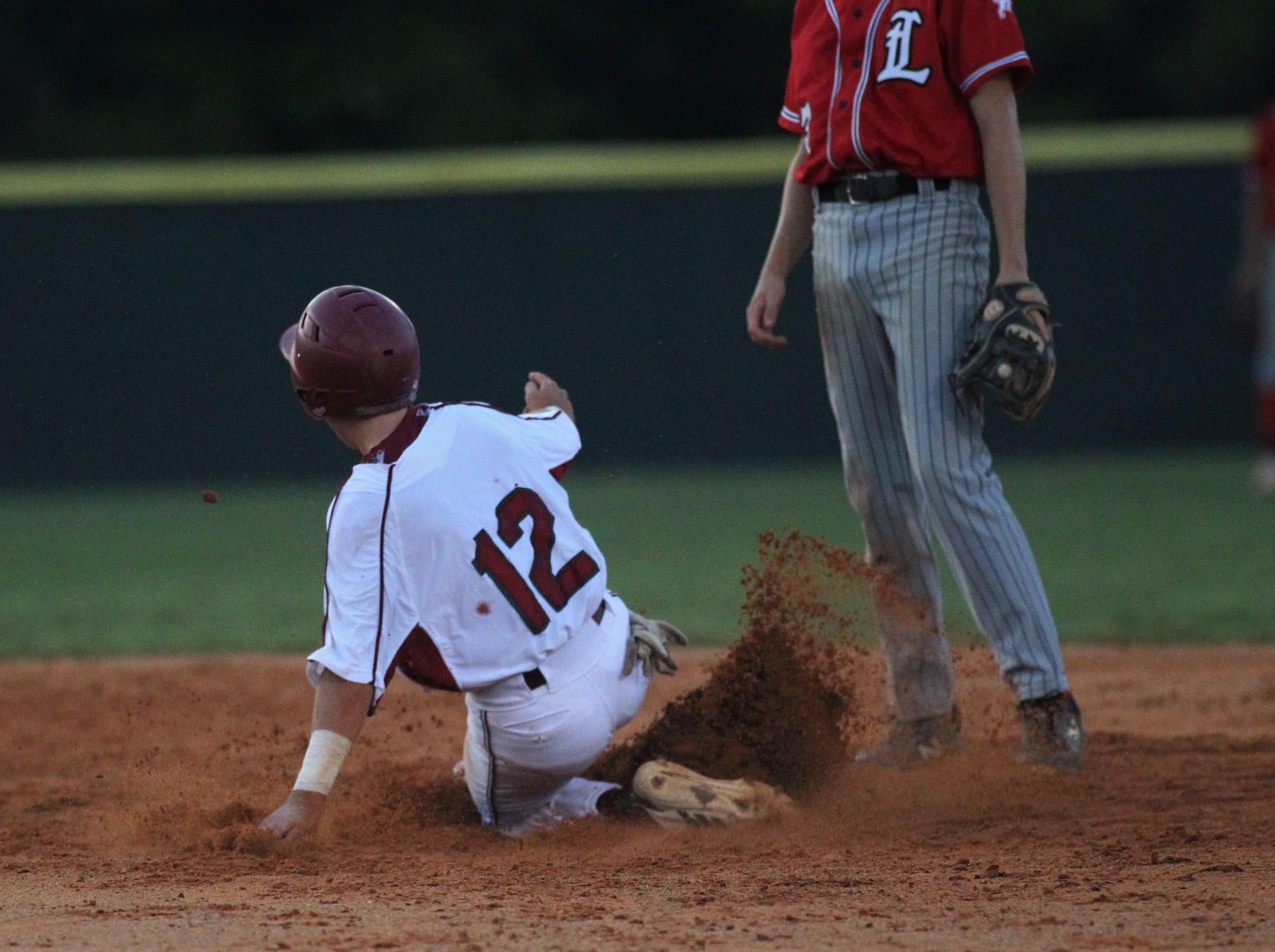 Chiles freshman Jaxson West steals second as Chiles beat Leon 10-6 during a District 2-8A semifinal on May 7, 2019.
