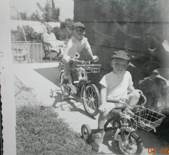 Joe Barnett, age 3, bicycling younger brother Jeff in front, in 1957.