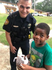 Officer Joe White and his new friend, who called 911 without his mom knowing.